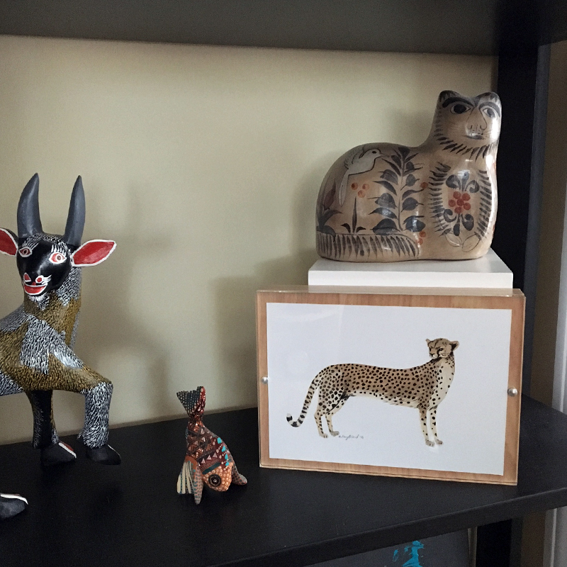 My new cheetah painting from Kelzuki, surrounded by Mexican folk art and alebrijes in my kitchen.