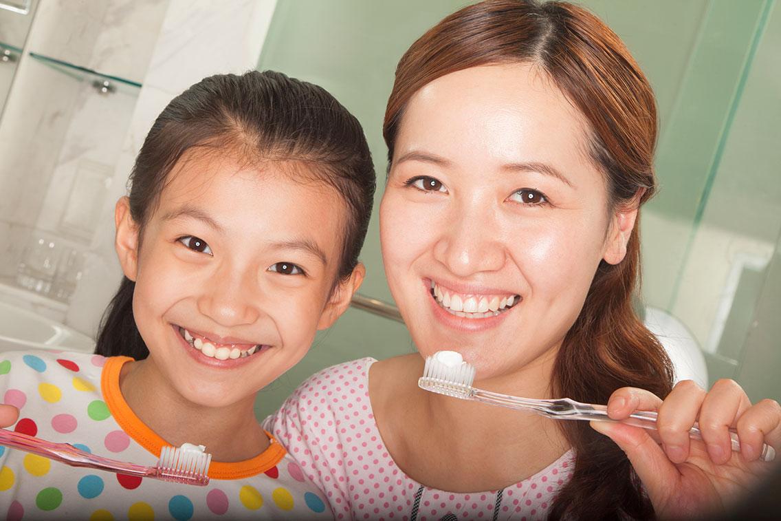 mother-daughter-brushing-teeth.jpg