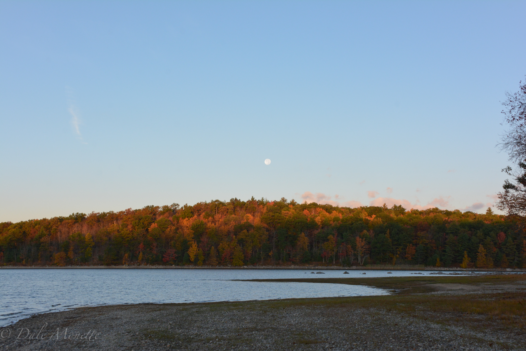 The moon setting over Moore Island on an early autumn morning.