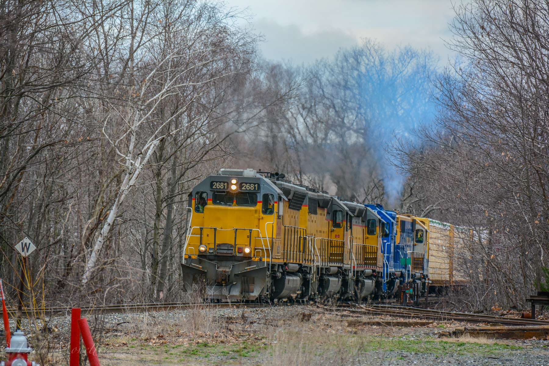 New England Central crawls across the Millers Falls bridge with a long trail….