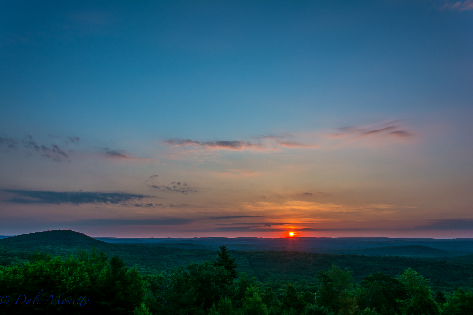 Sunrise on a hot summers morning. New Salem MA looking over the northern Quabbin and the southern part of Athol, MA. 7/12/16