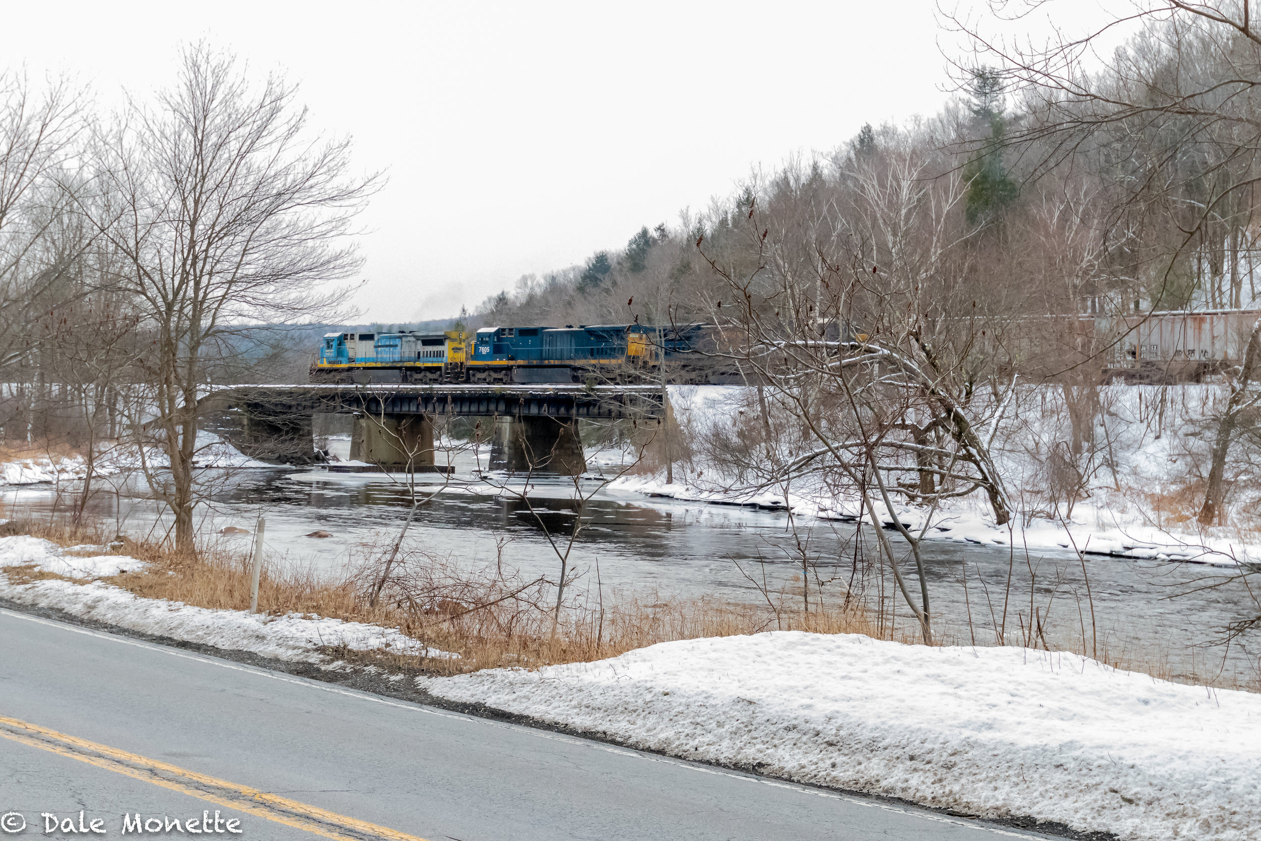 Eastbound Pan Am RR freight train heading over the Millers River in Erving MA taken from RT 2.