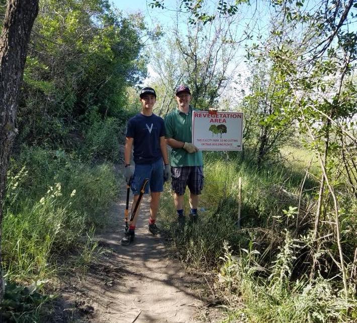 Pleasant Grove Biking Vikings designating a revegetation area at the Valley Vista Trail System.