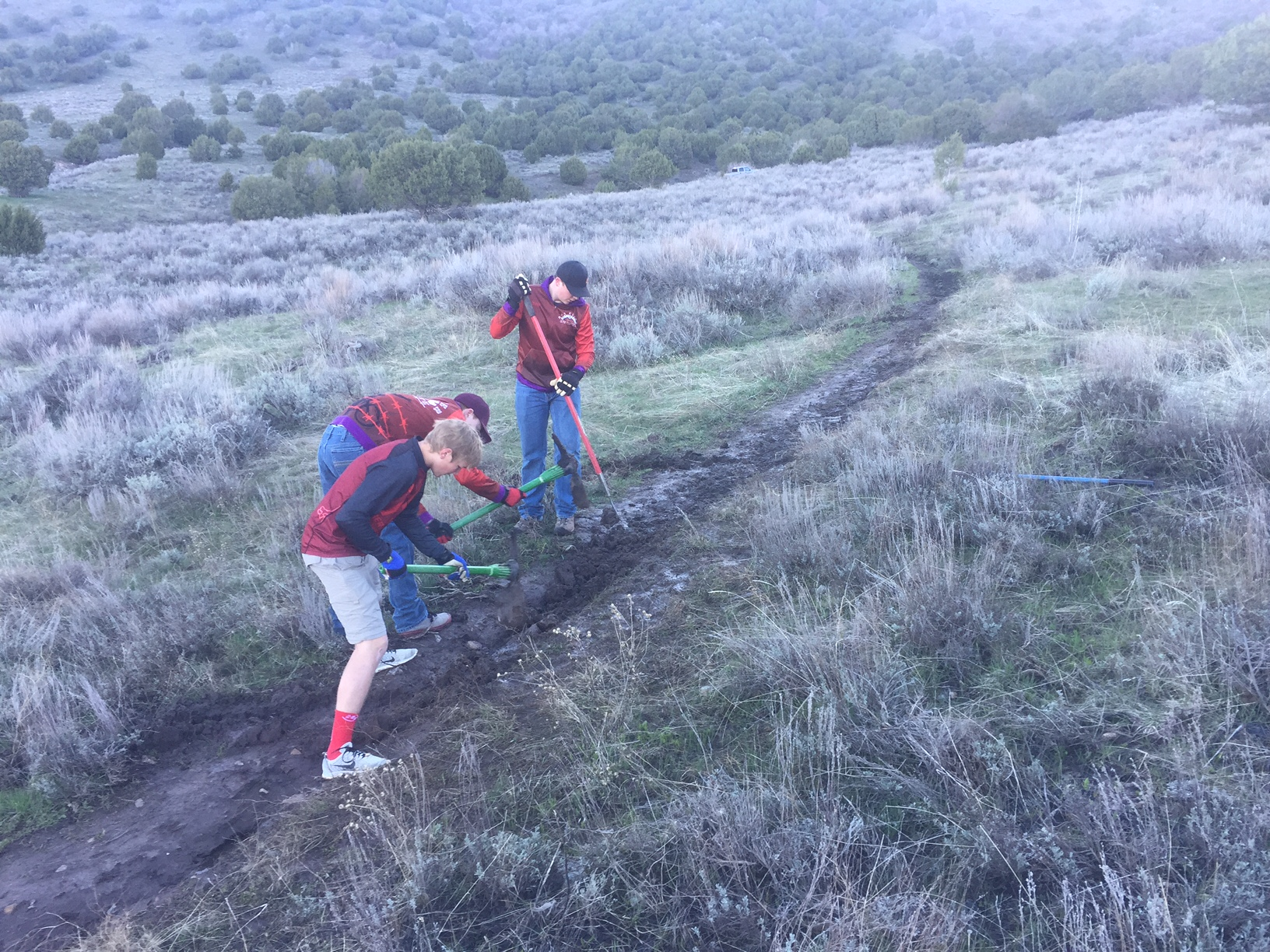 Pictured above: Box Elder Composite Team providing care to fix ruts on a muddy trail - 2017