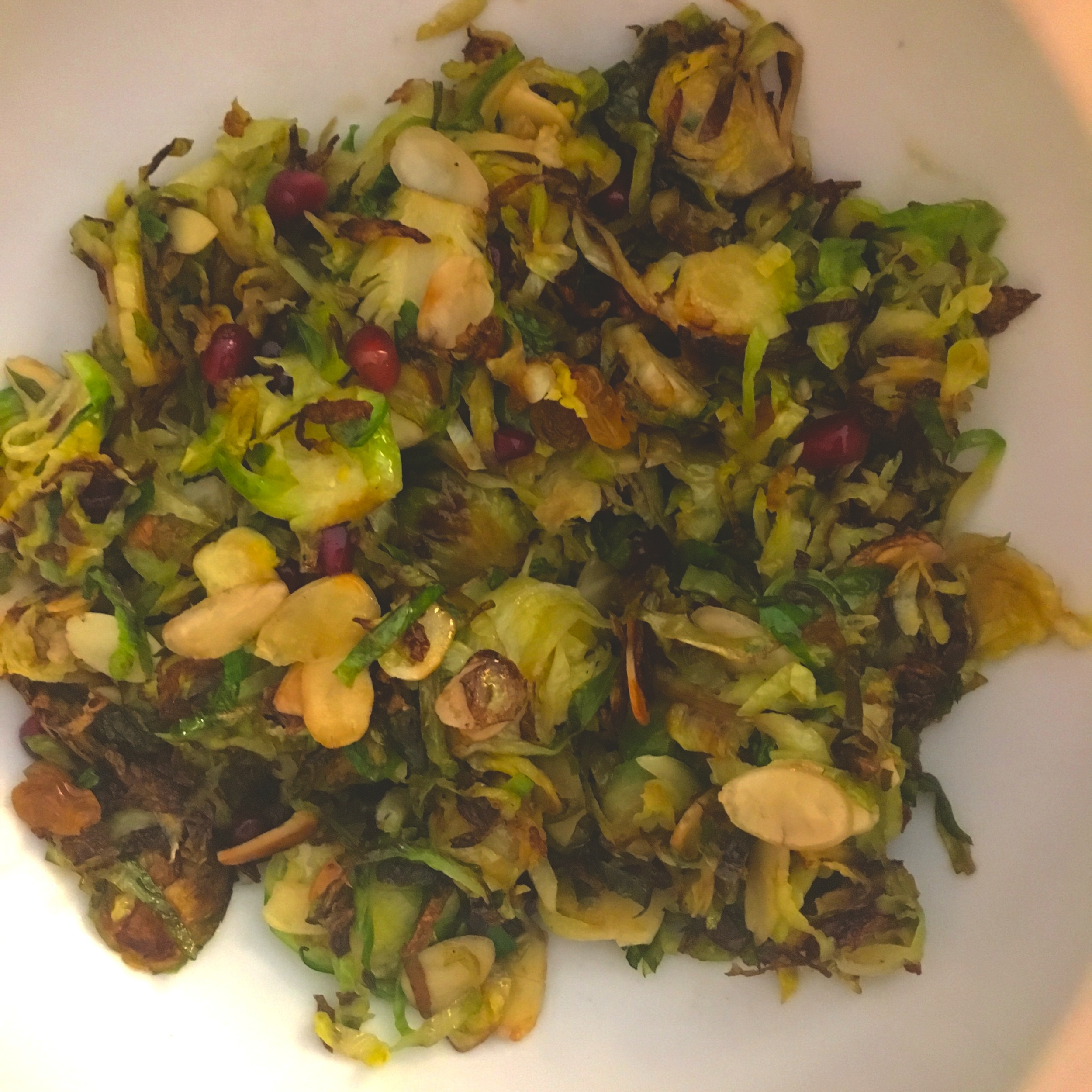 Shaved brussels sprouts, shown here with sliced almonds