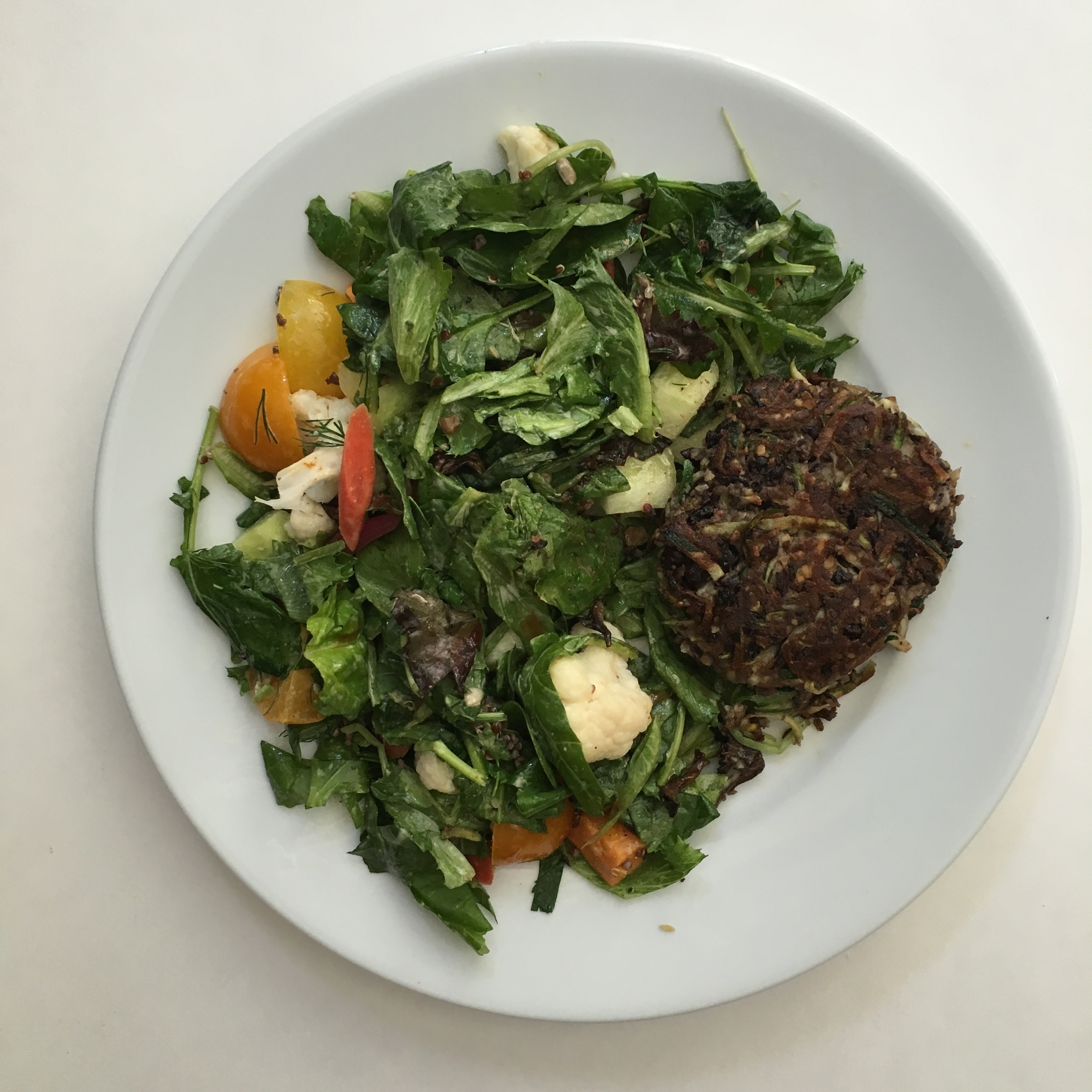 veggie burger over greens