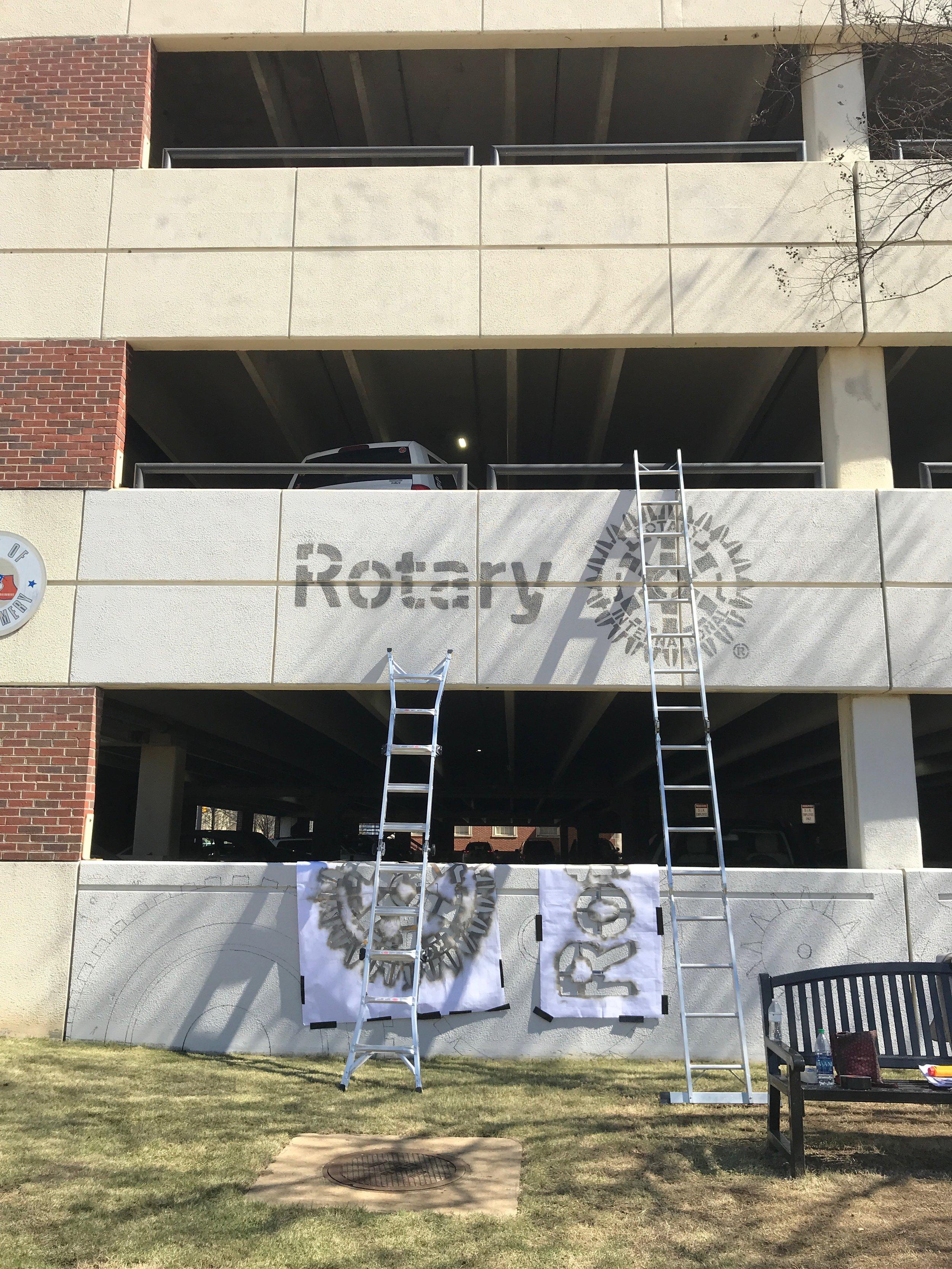 Day Four: Rotary Club logo stencil goes up!