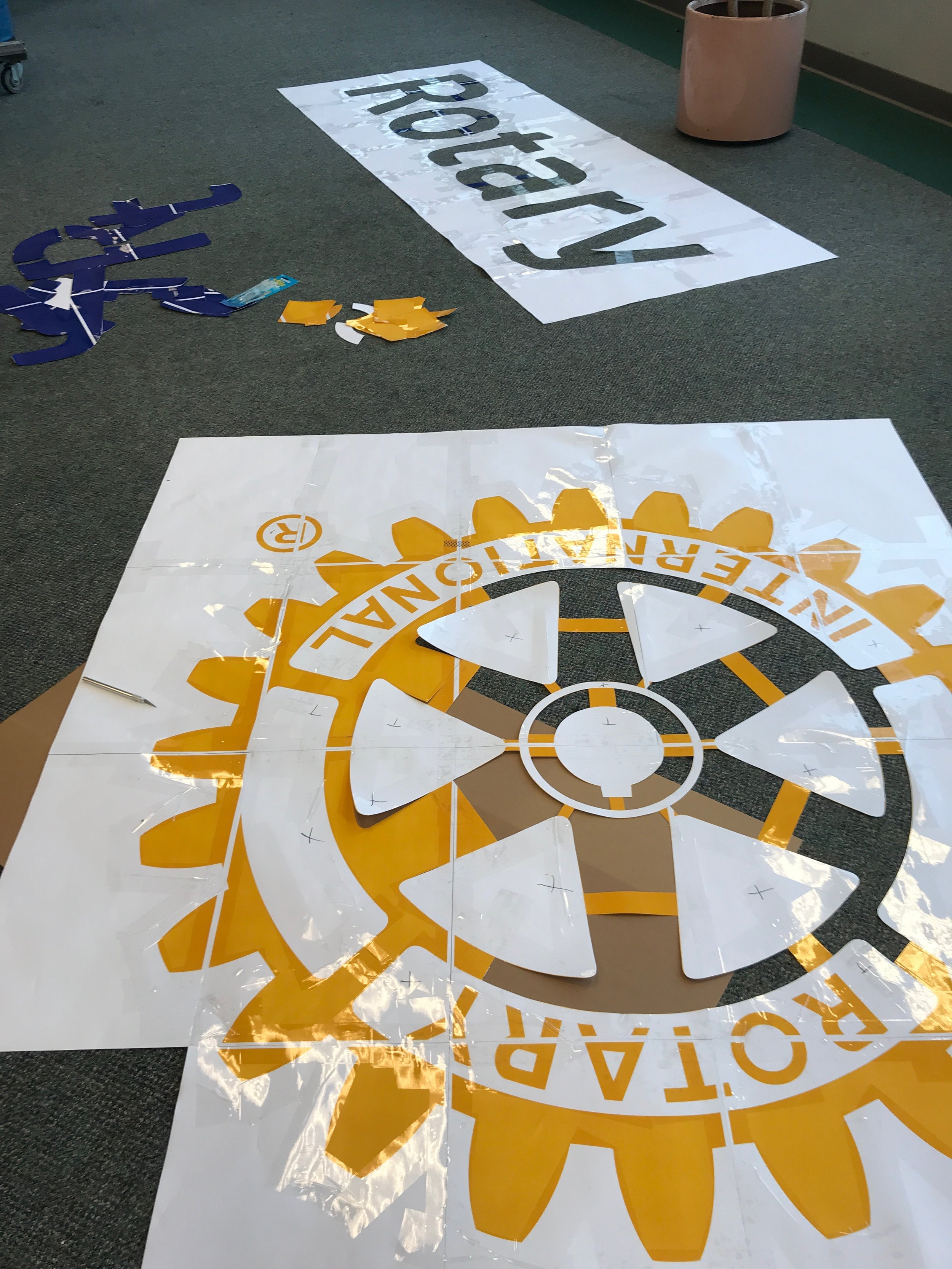Rotary Club logo stencil, 12' x 5' total. Ten hours of labor to X-acto knife and tape.