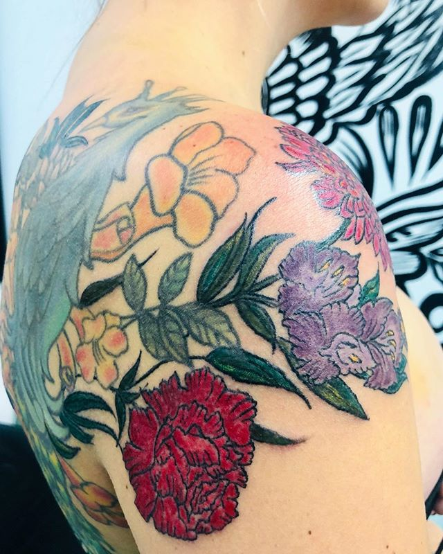 Today color work on these  beautiful flowers to honor her family. I added onto this pre-existing Peacock and we're going to give the Peacock the transformation next session #floral #floraltattoo #tattoo #ink #instagram #beauty #peony #gladiolus #snowdrops #carnation #ladytattooer #portlandmaine #13moonstattoostudio #pretty