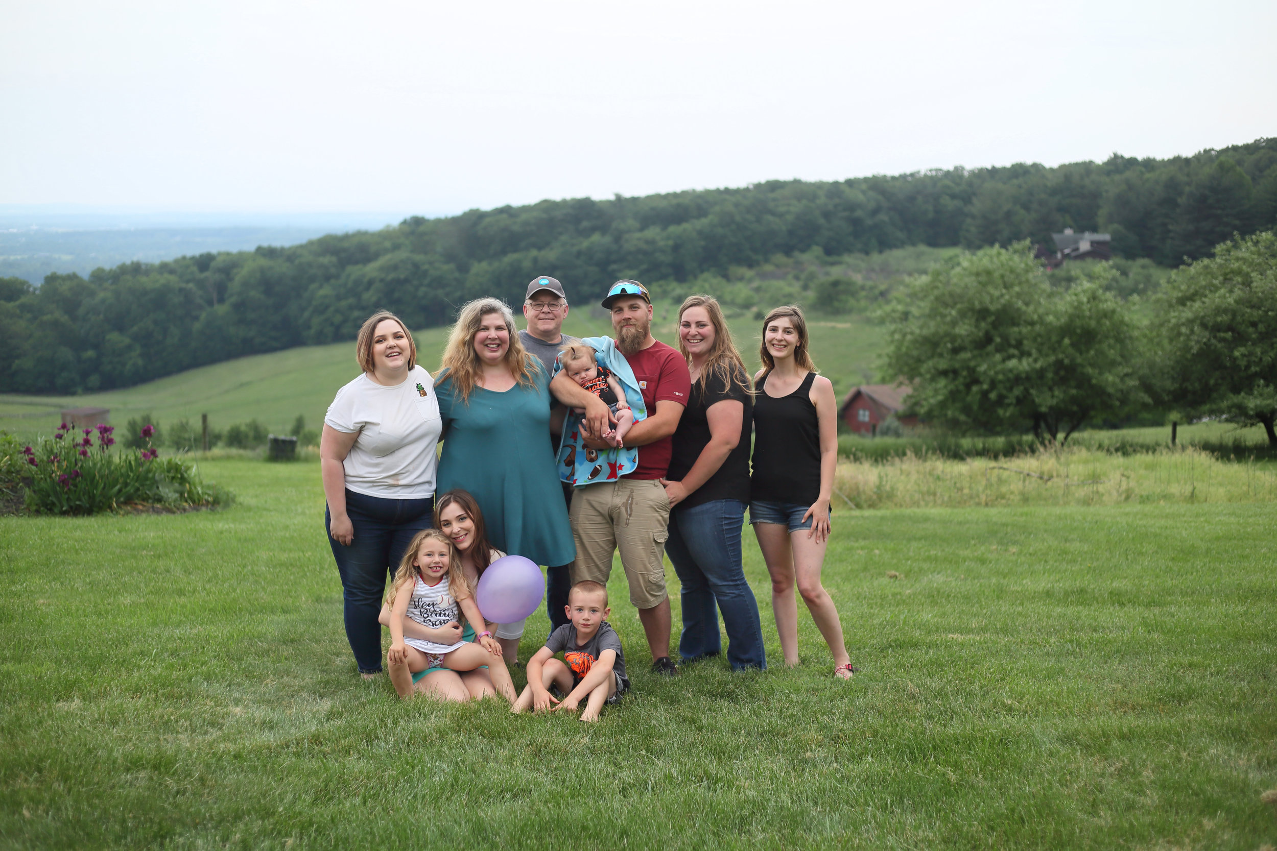 We were so fortunate to have permission to use Tyler's Aunt's property to take advantage of this incredible view of Thurmont. First full family photo since the new addition. Minutes before we took this, Raegan found some relief and milk-puked all over Noah (note the strategic placement of the baby blanket).
