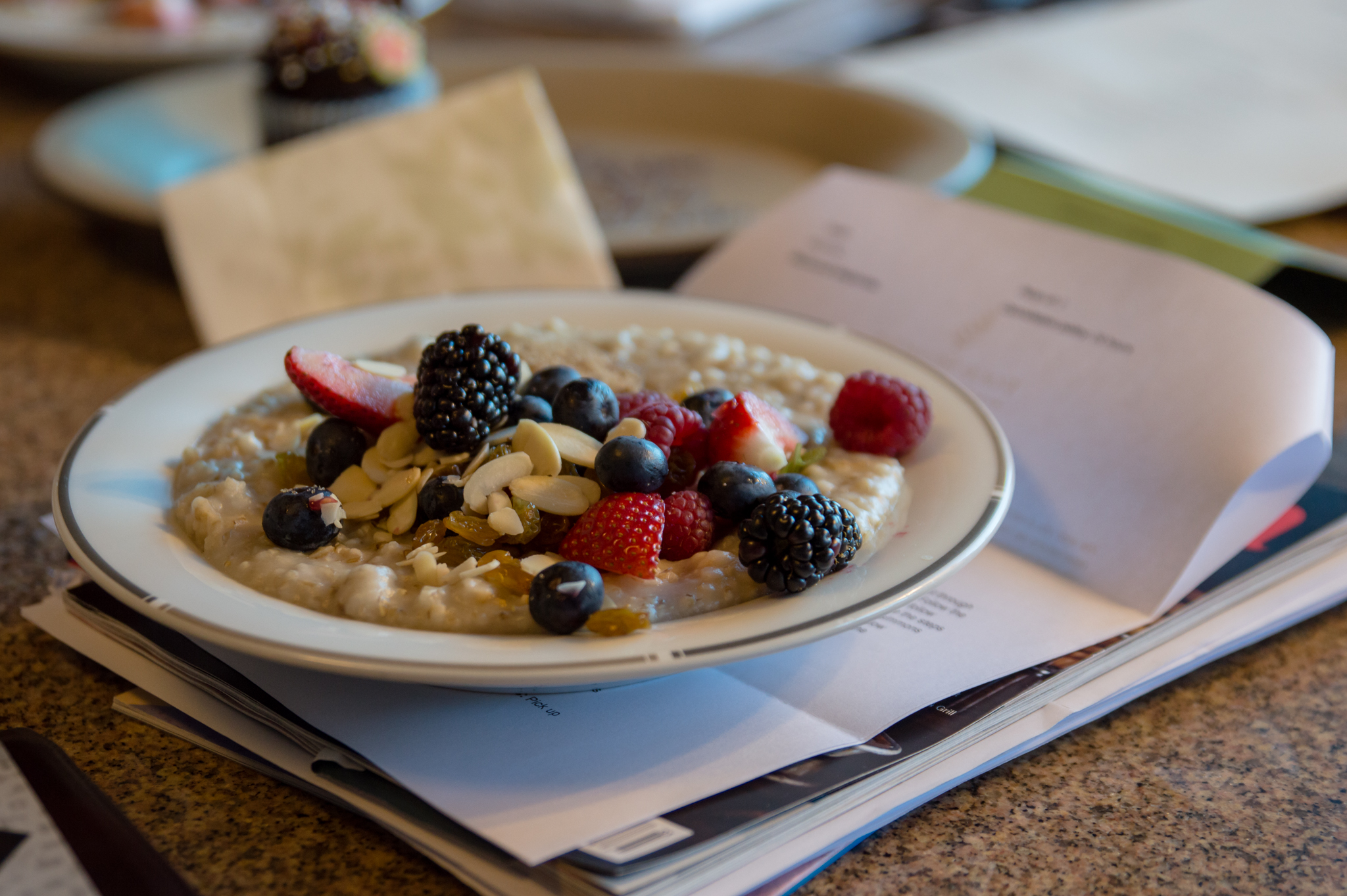 A bowl of oatmeal with slivered almonds, please.