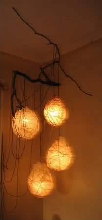 """Orbs   (56"""" x 62"""" x 50"""")   mixed media: rice paper, bamboo, branches, thread,   electrical cord, light fixtures, lightbulbs"""