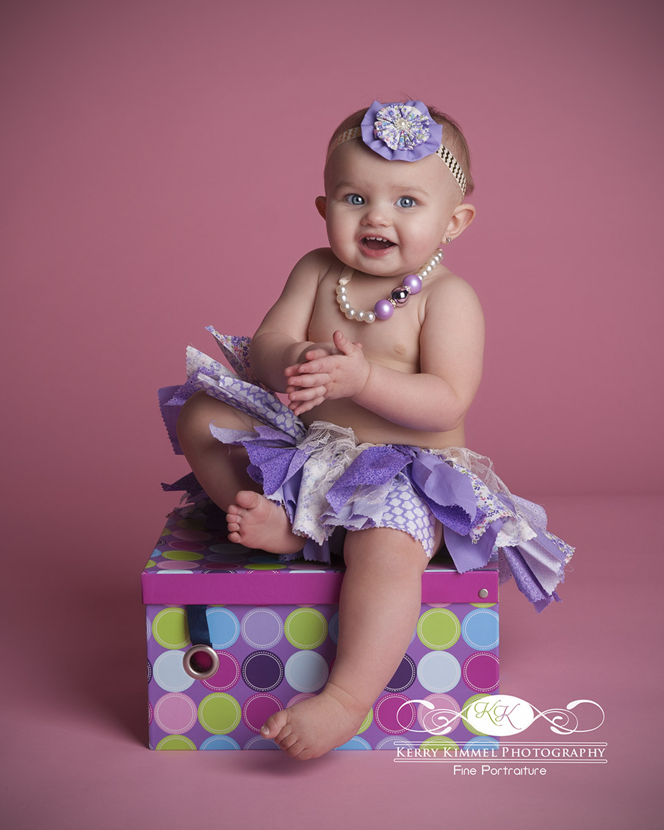 Such a doll in her purple tutu!