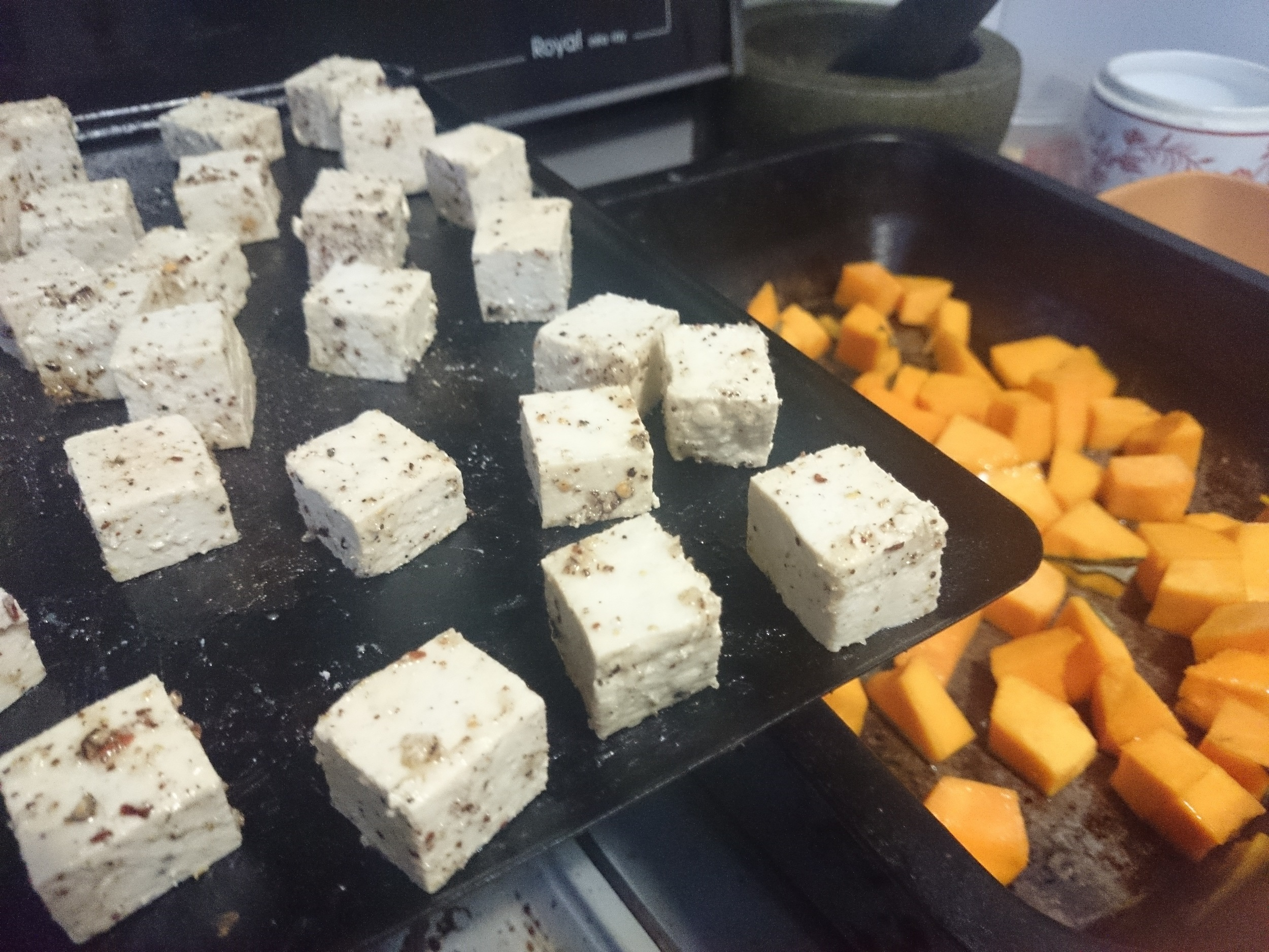 Pre-cooking bits & pieces: marinated tofu & spiced pumpkin about to go in the oven