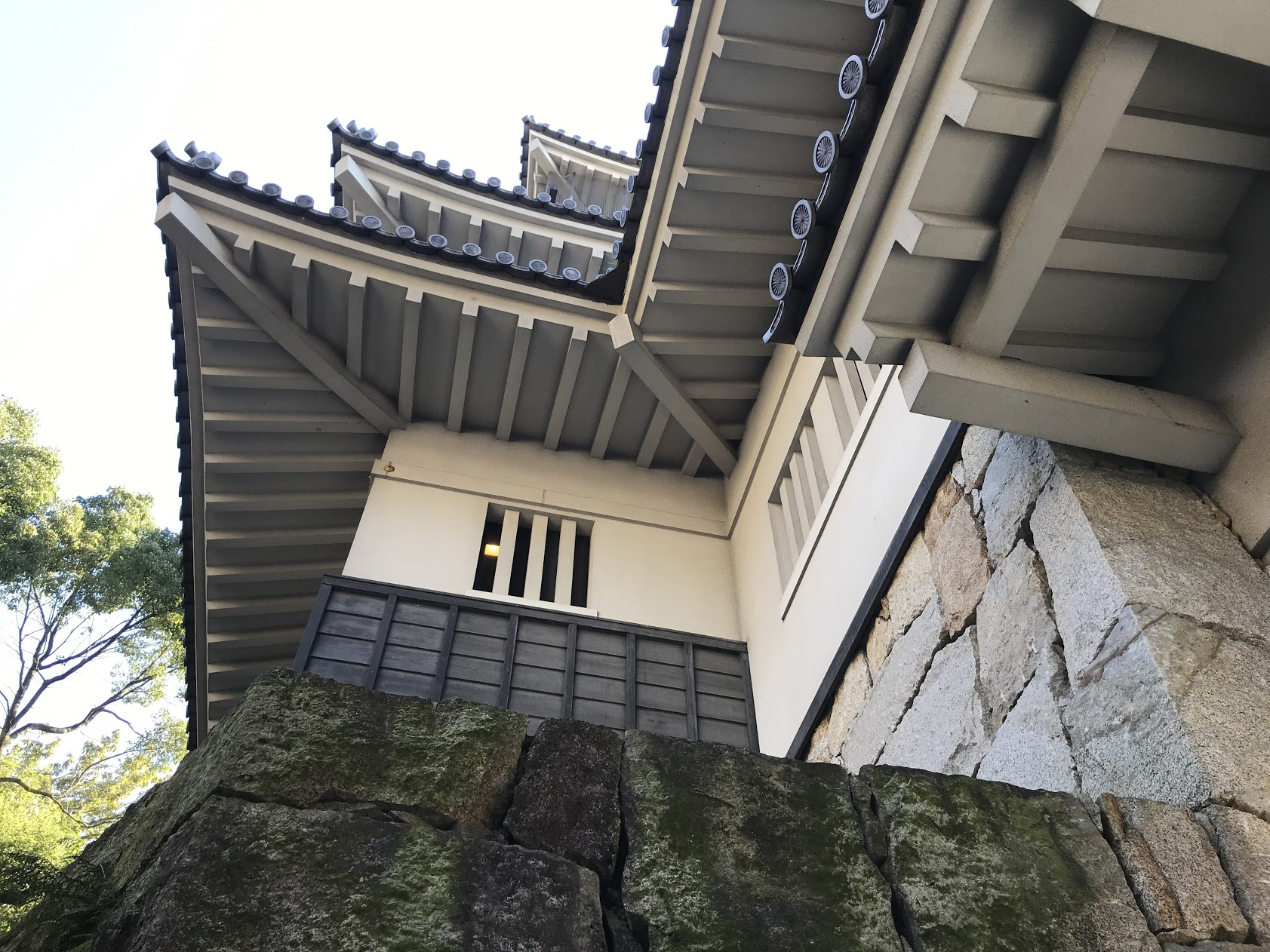 Looking up at a Japanese Castle, a common site in Japan. Every city seems to have a fortress or castle to tour. It's fascinating to study their history and see how it has shaped their culture.