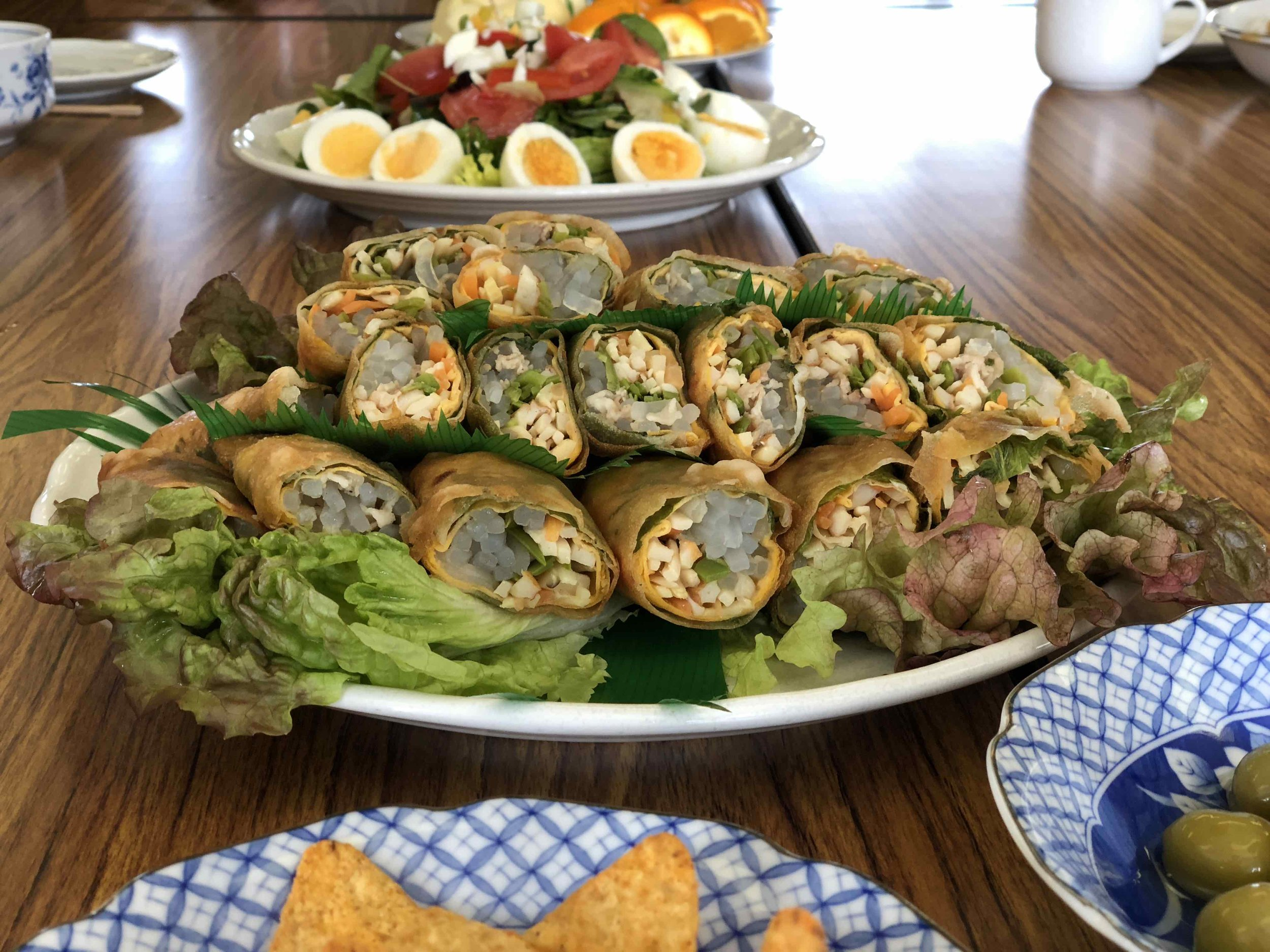 Lots of interesting and new foods! This is a colorful spring roll appetizer at church.
