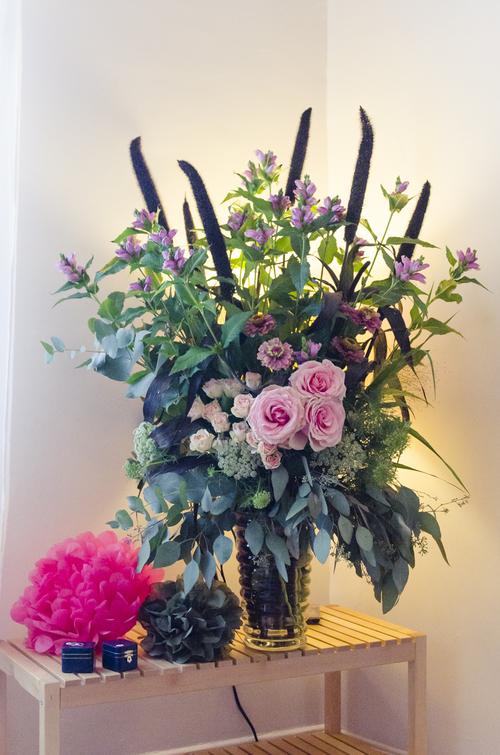 Bridal floral arrangement in vase.