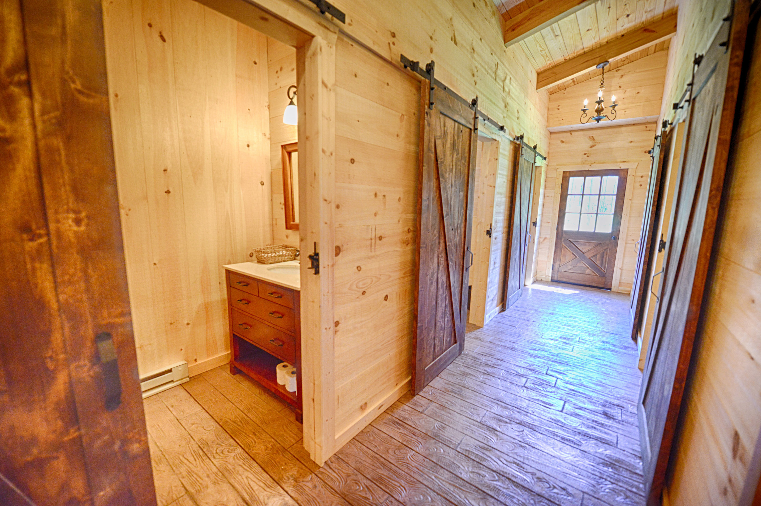 7 private restrooms with sliding barn doors