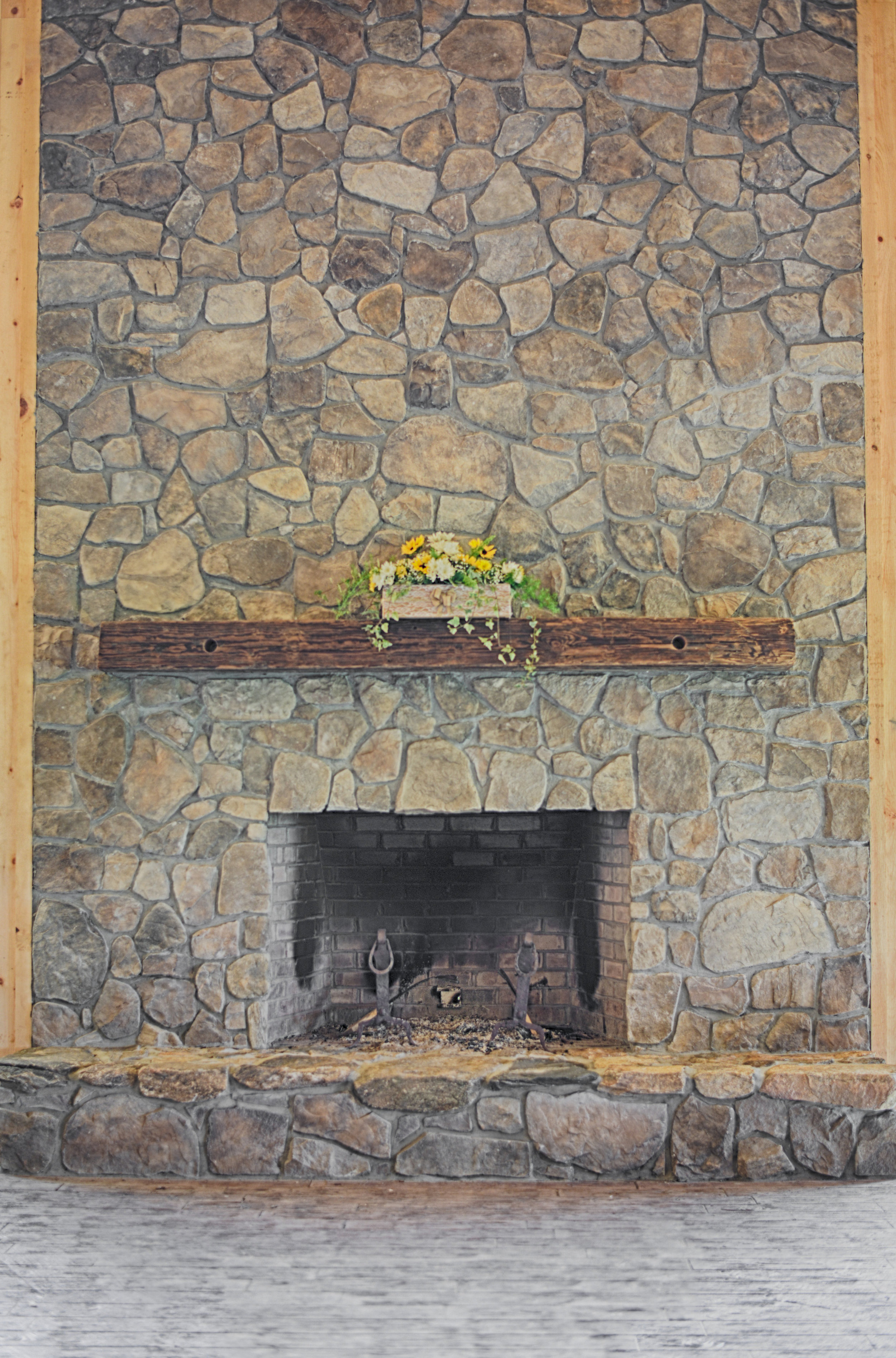 Our floor-to-ceiling stone fireplace makes for a stunning backdrop in your photos