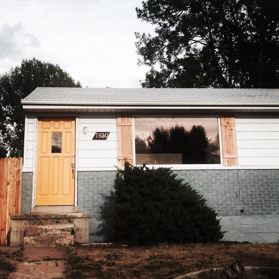 After - painted exterior, built shutters and fence.