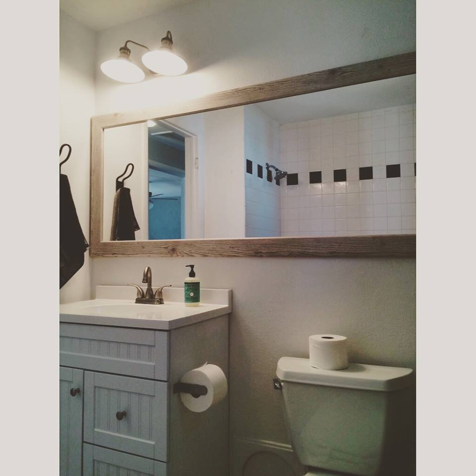 After - new vanity, mirror, hardware and tile floor
