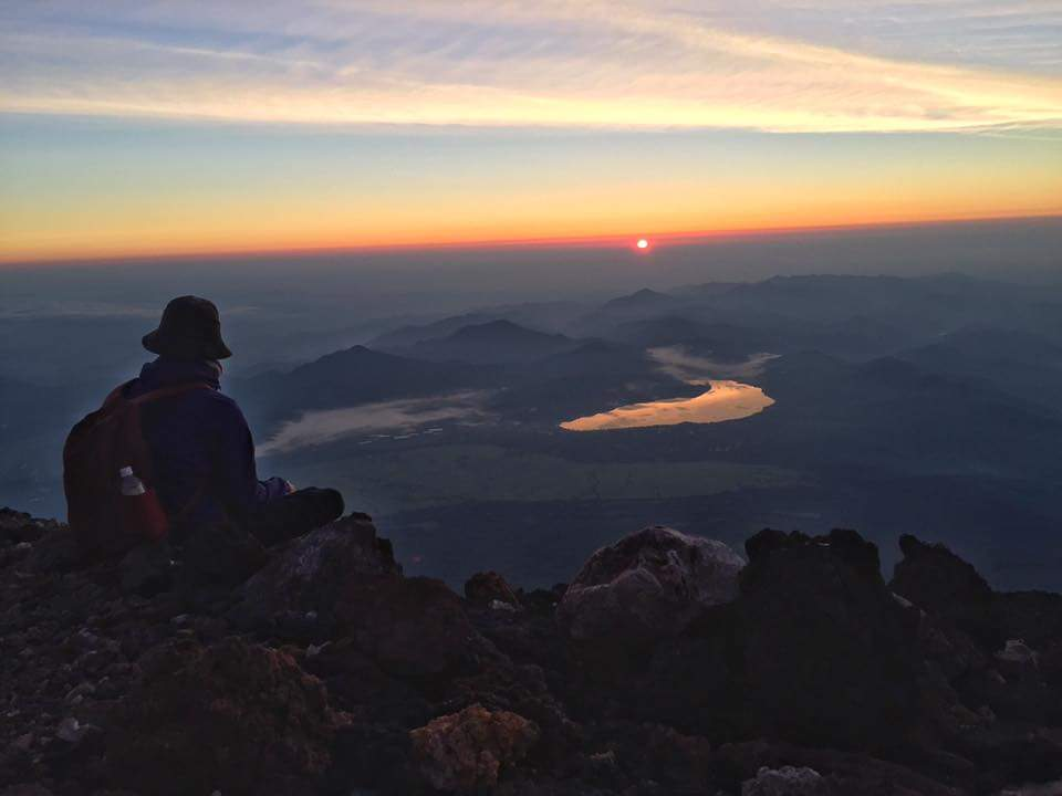 Watching the sunrise on the summit of Mt. Fuji.