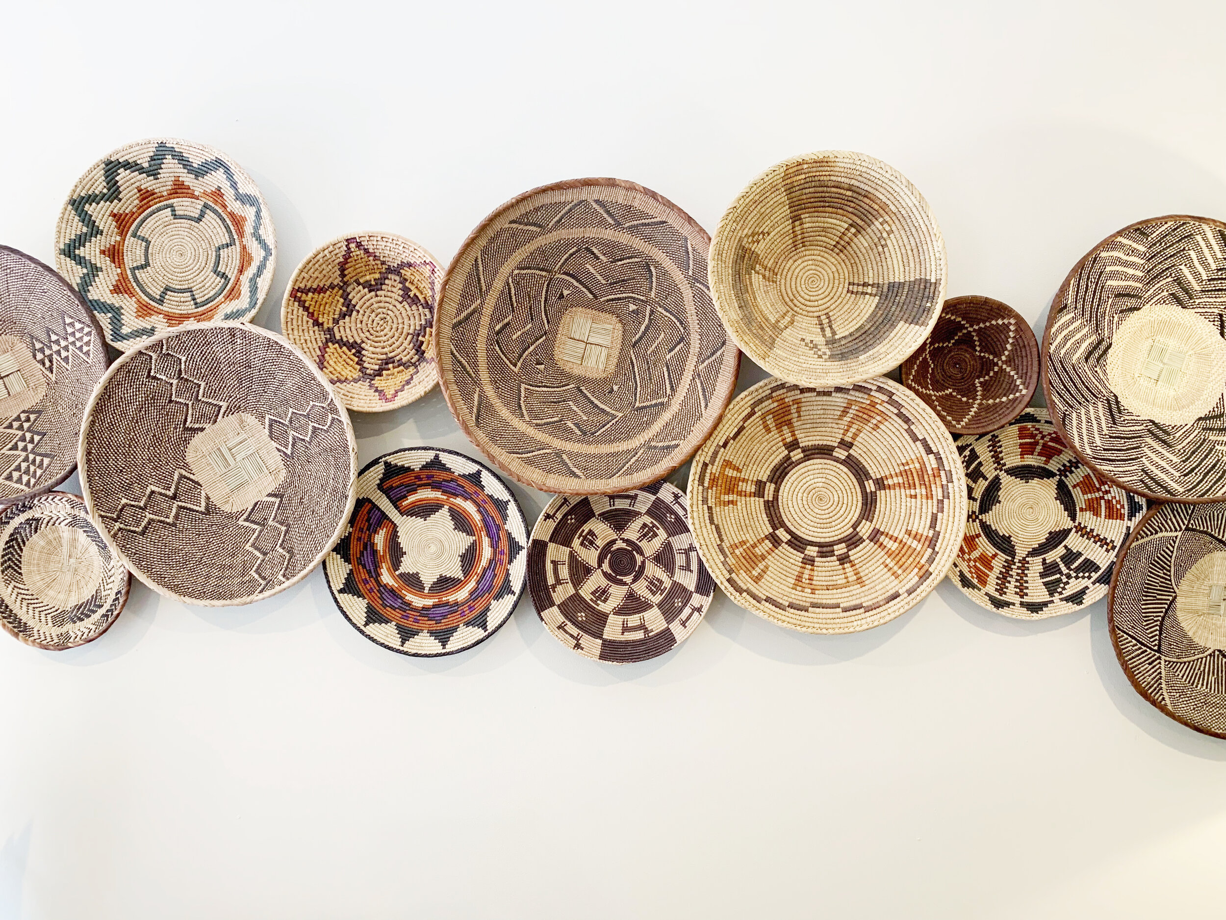 My collection of both Native American and African baskets creates a textural decorative piece.