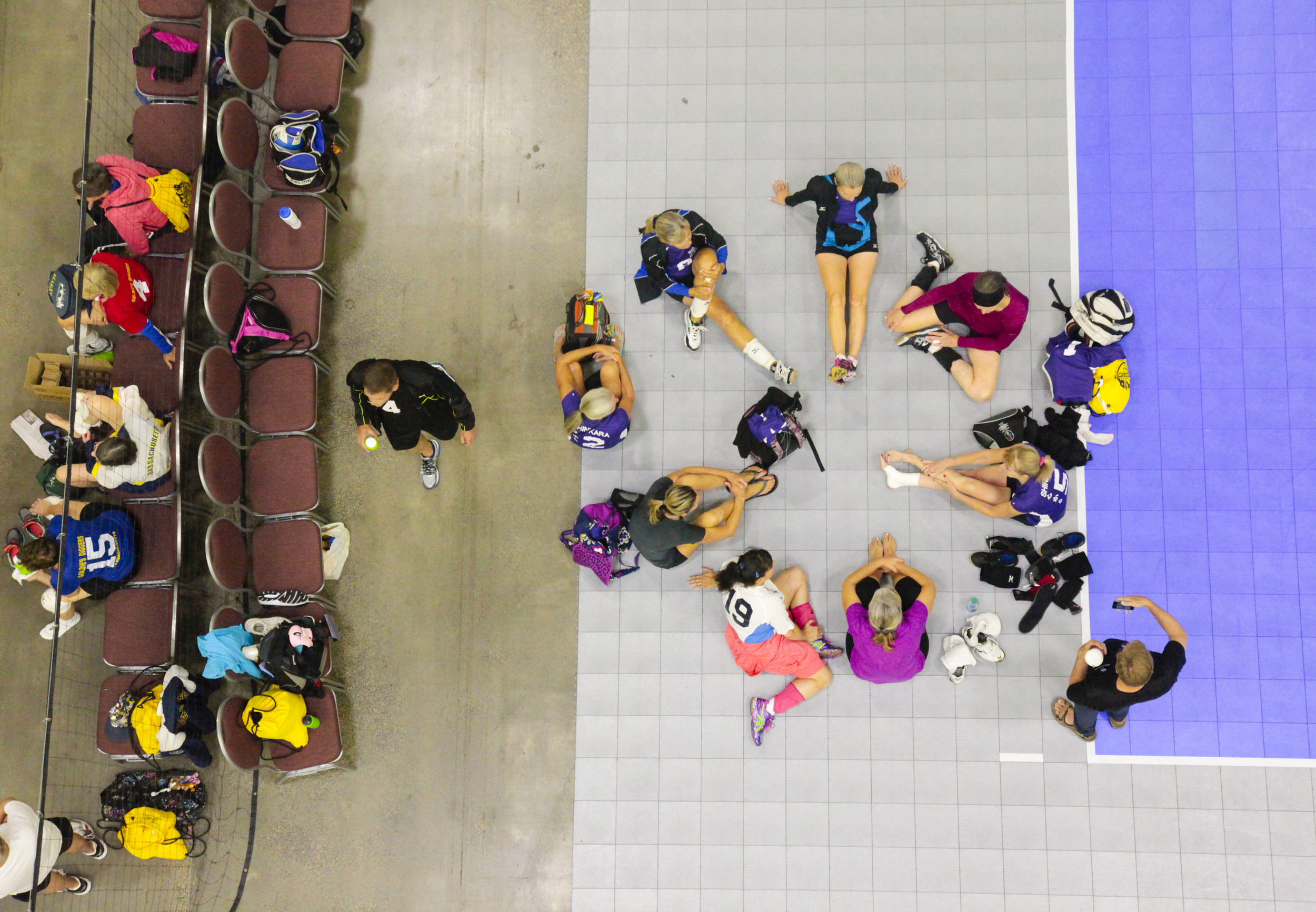 The Shinkara volleyball team relaxes after finishing a volleyball match that took place during the 2015 National Senior Games Volleyball Competiton on Jul. 15, 2015 in Minneapolis, MN.