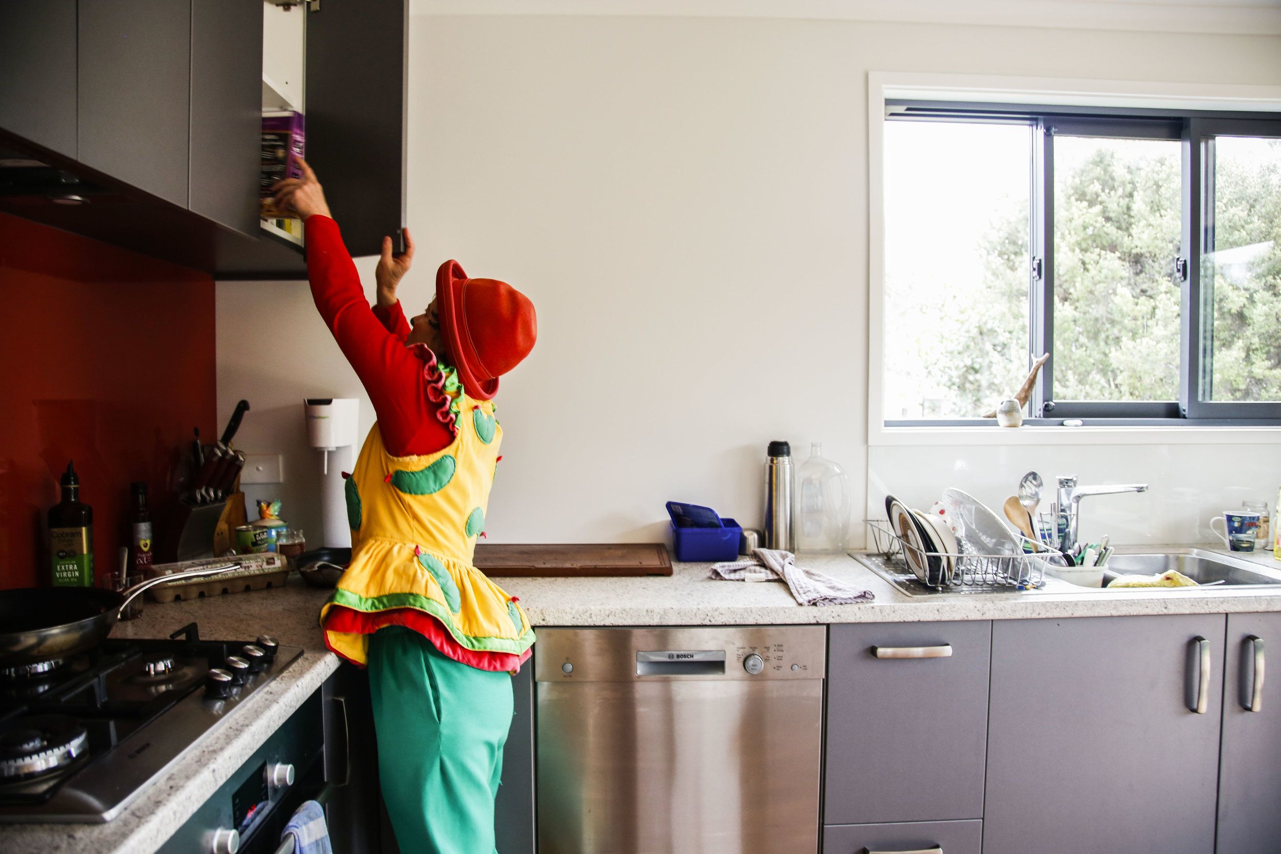 Lisa goes through her kitchen cupboard in her newly remodeled Christchurch, NZ home.