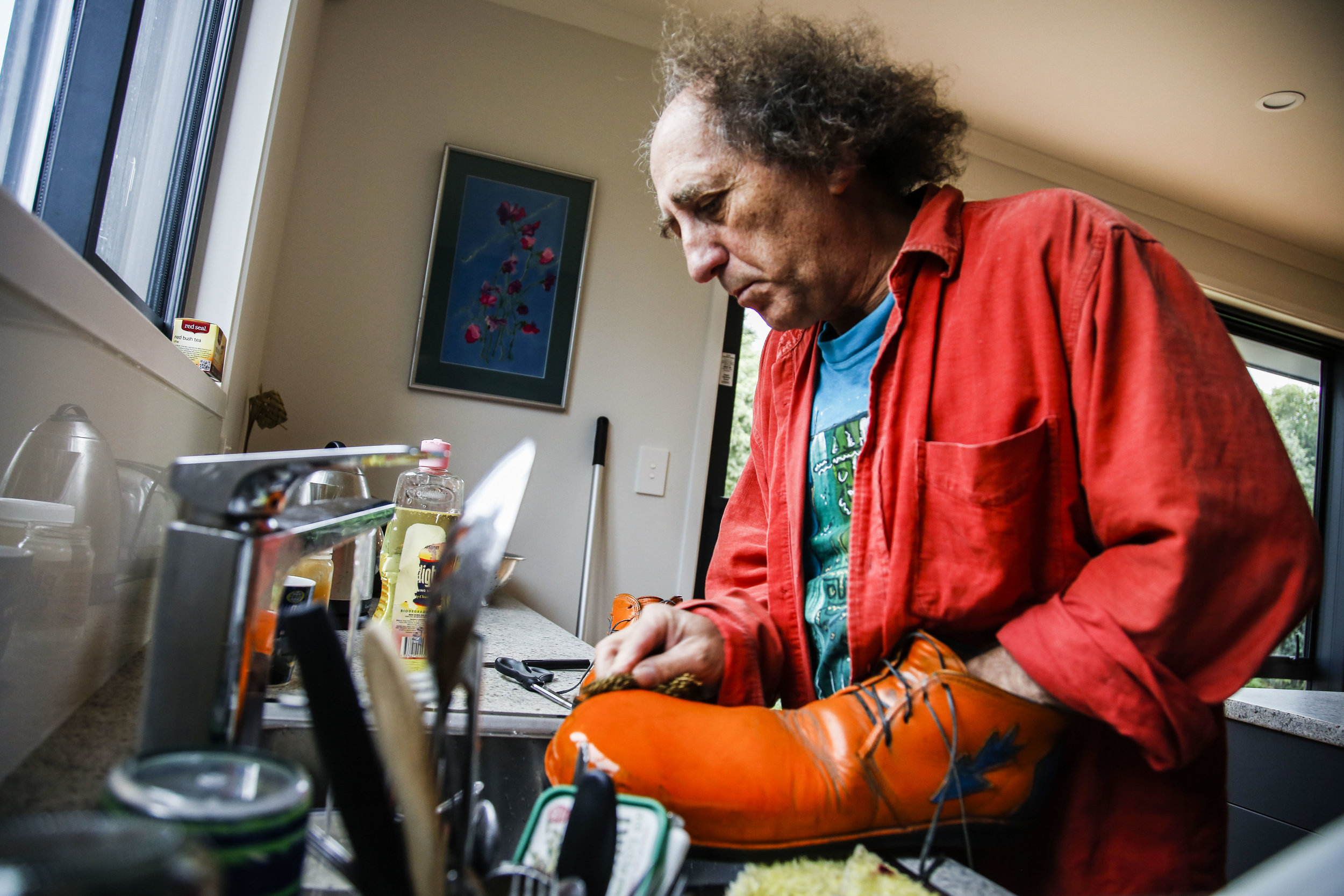 "Chris Carrow washes his clown shoes in his Christchurch, NZ home on May 6, 2016 in preparation for his show with Wingfield at Rāwhiti School. ""I guess clowning, in a way, is about truth. You have to be true to yourself and you have to be true to what you're doing. The clown is only there because we're trying to lighten up the day. We're here to entertain and hopefully make a difference and make people happy."""