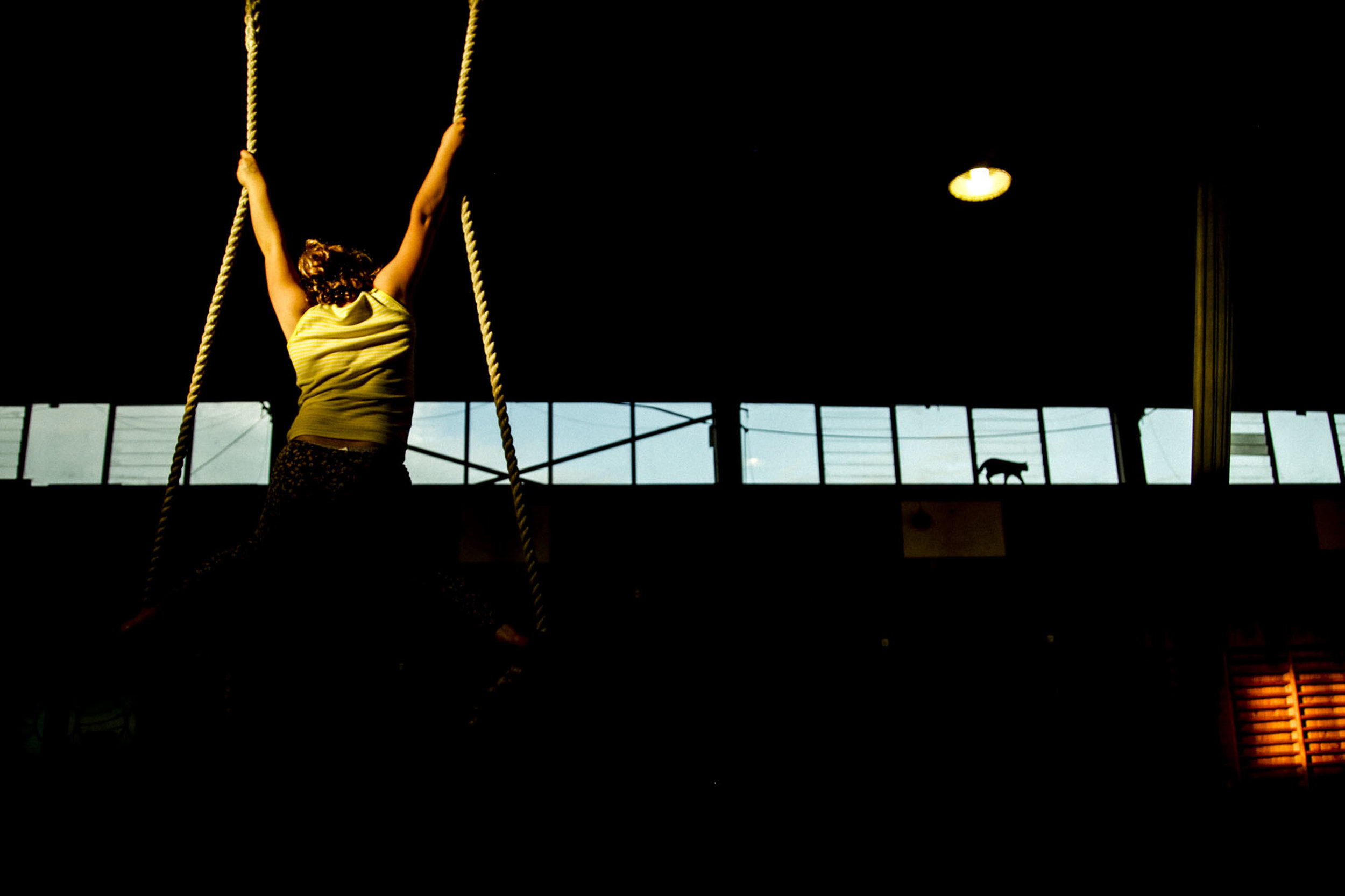 A student at the Christchurch Circus Centre hangs on a trapeze during class on May 10, 2016 in Christchurch, NZ.