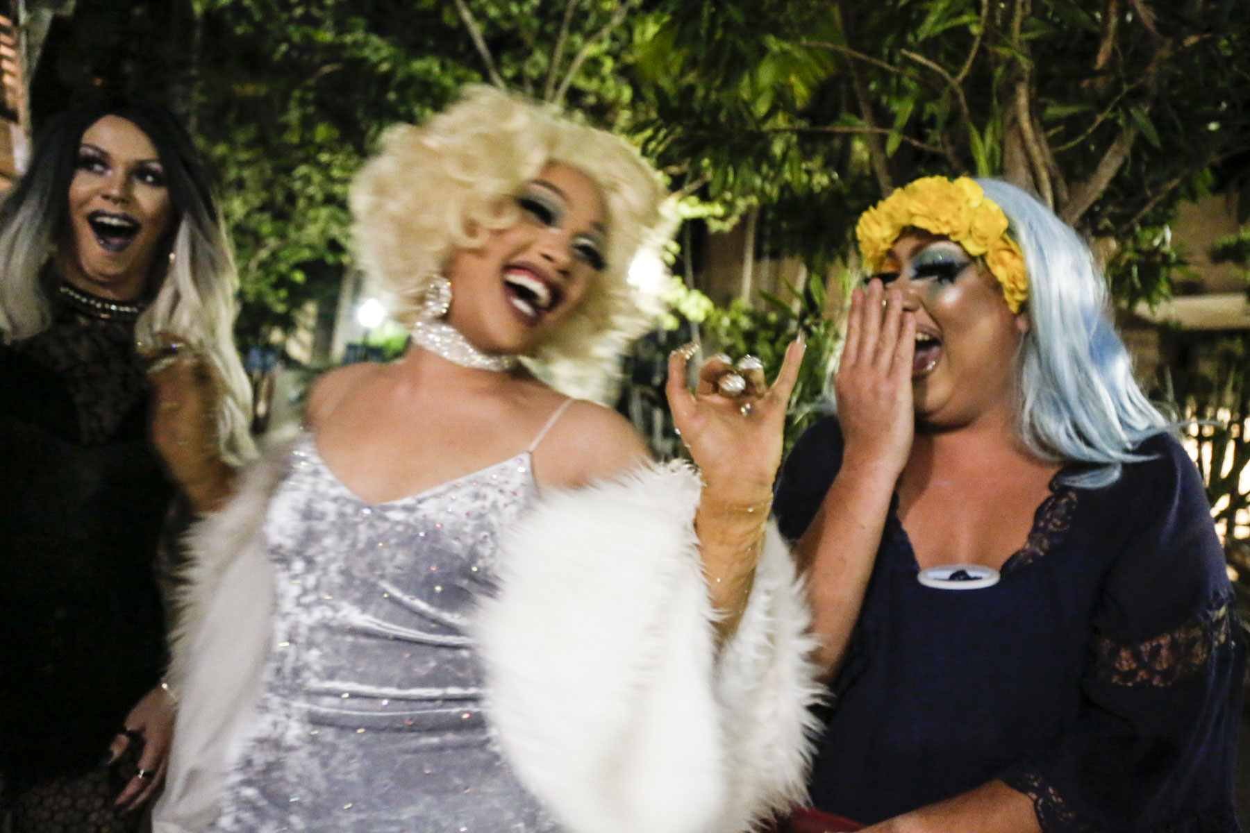 Aria Del Rey (left), Lolita (middle), and Apple Aday (right) share a laugh together outside of Scarlet in Honolulu, HI. They all consider each other sisters but rarely get to spend time together outside of the club. Aria Del Rey has only been doing drag for a few months and just recently became a part of the Del Rey family.