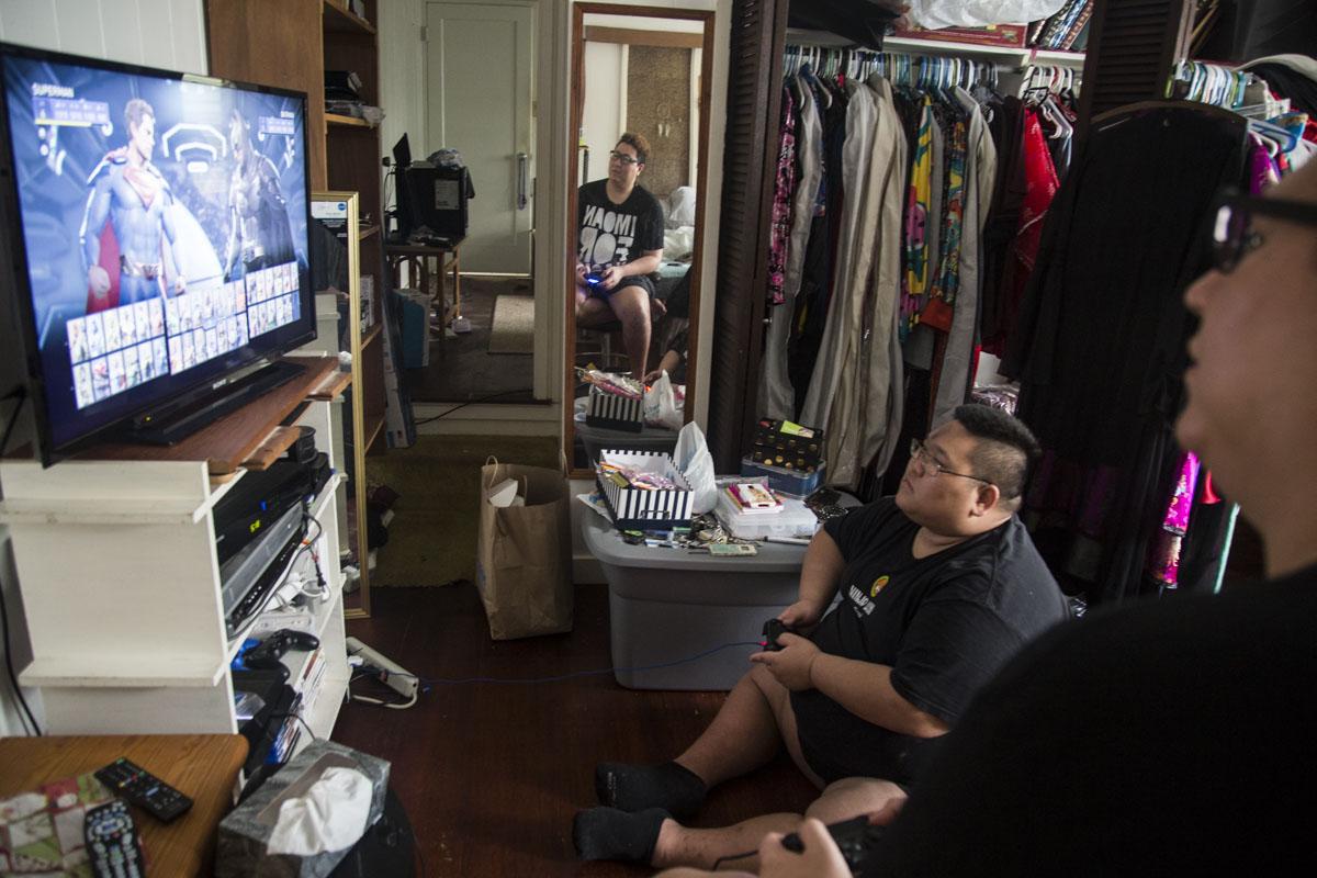 The Fruity Queens play video games at Kalista Fox's (a fellow drag queen) home in Aiea, HI.