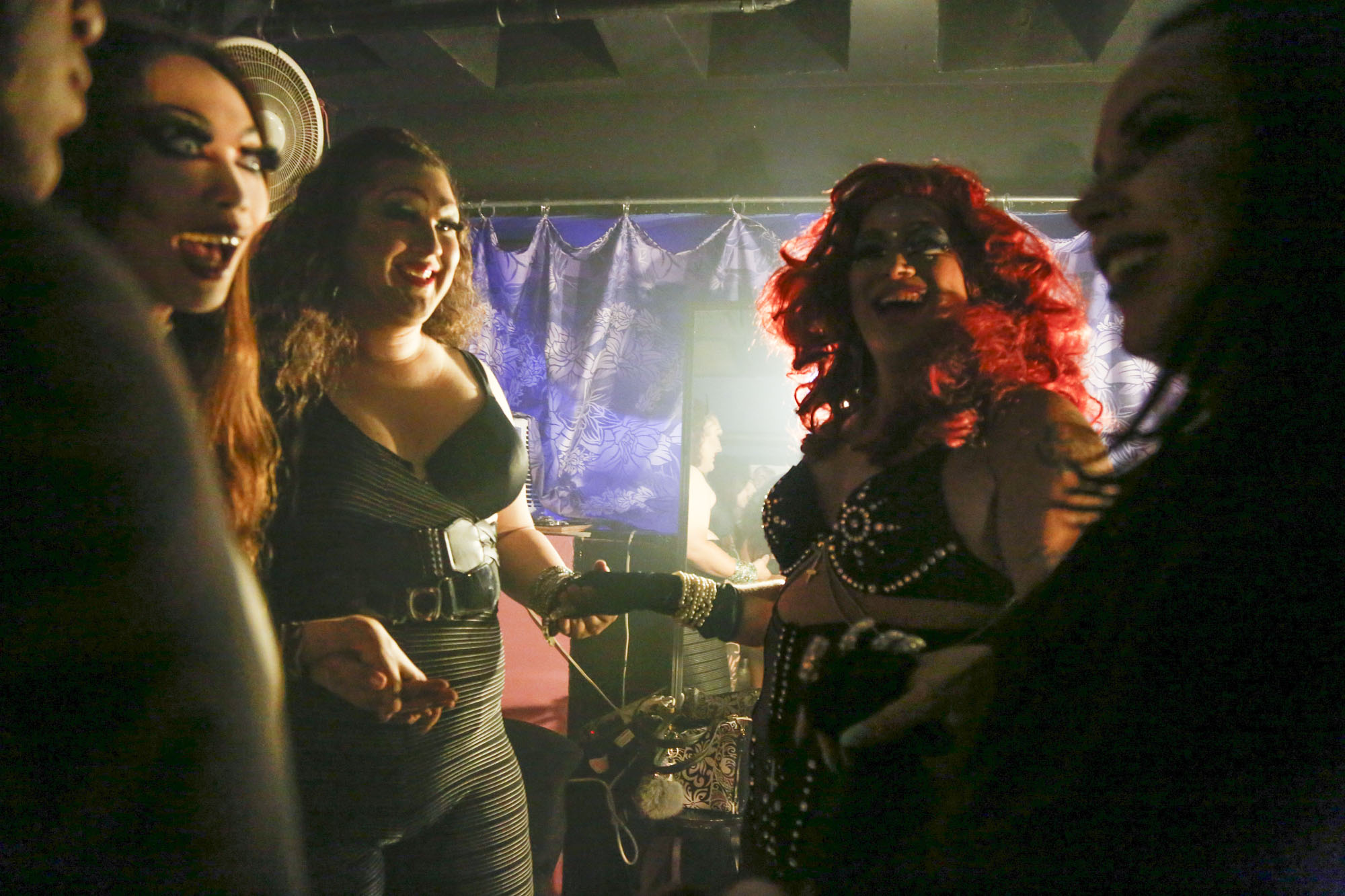 (From left to right) Zanaiyah Cage, Sarina Sena Daniels, Kalista Fox, Lilith Satana and Aria Del Rey hold hands and say words of encouragement to one another before the premiere performance for their group, Diamonds in the Muff. Satana, the leader of the group, says that he's never felt the sisterhood of drag until now. He's struggled to hold the respect of many queens since the beginning of his career and is now starting to get recognized for his talent.