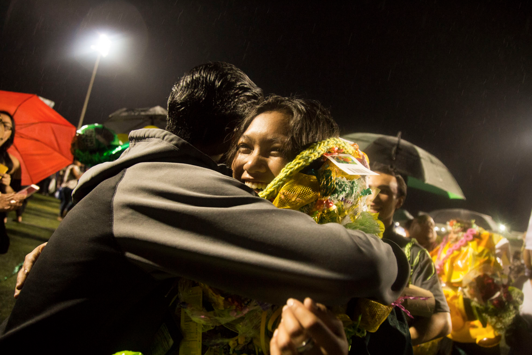 BB (left), a family friend, hugs Catherine during her high school graduation on May 25, 2018. Catherine was the very last Hobro to graduate from Leilehua High School.