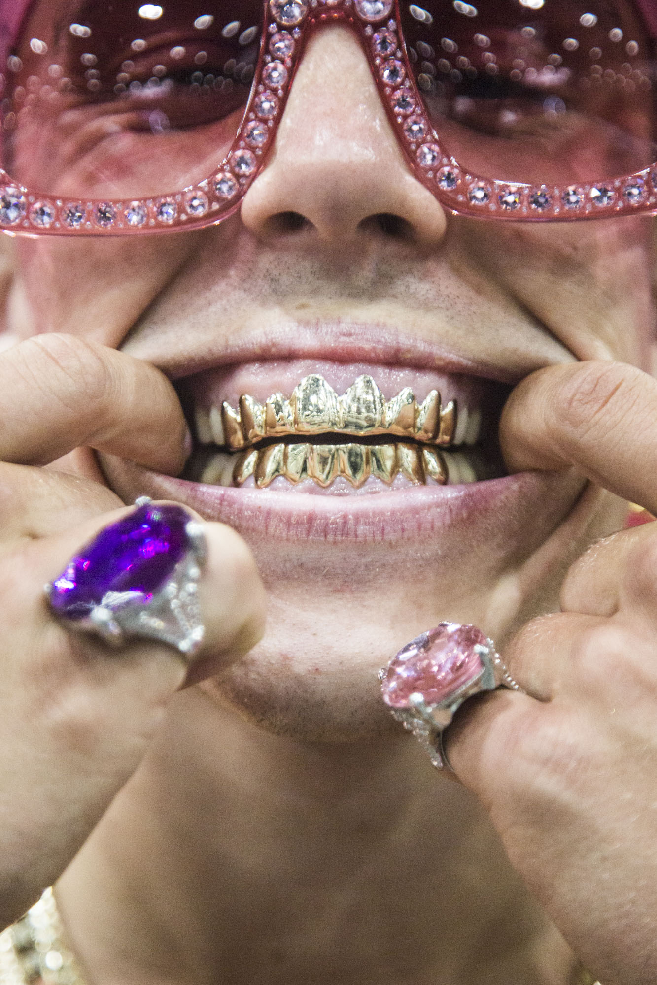 Candy Ken shows off his grills during RuPaul's DragCon LA in Los Angeles, Calif. on May 12, 2018.