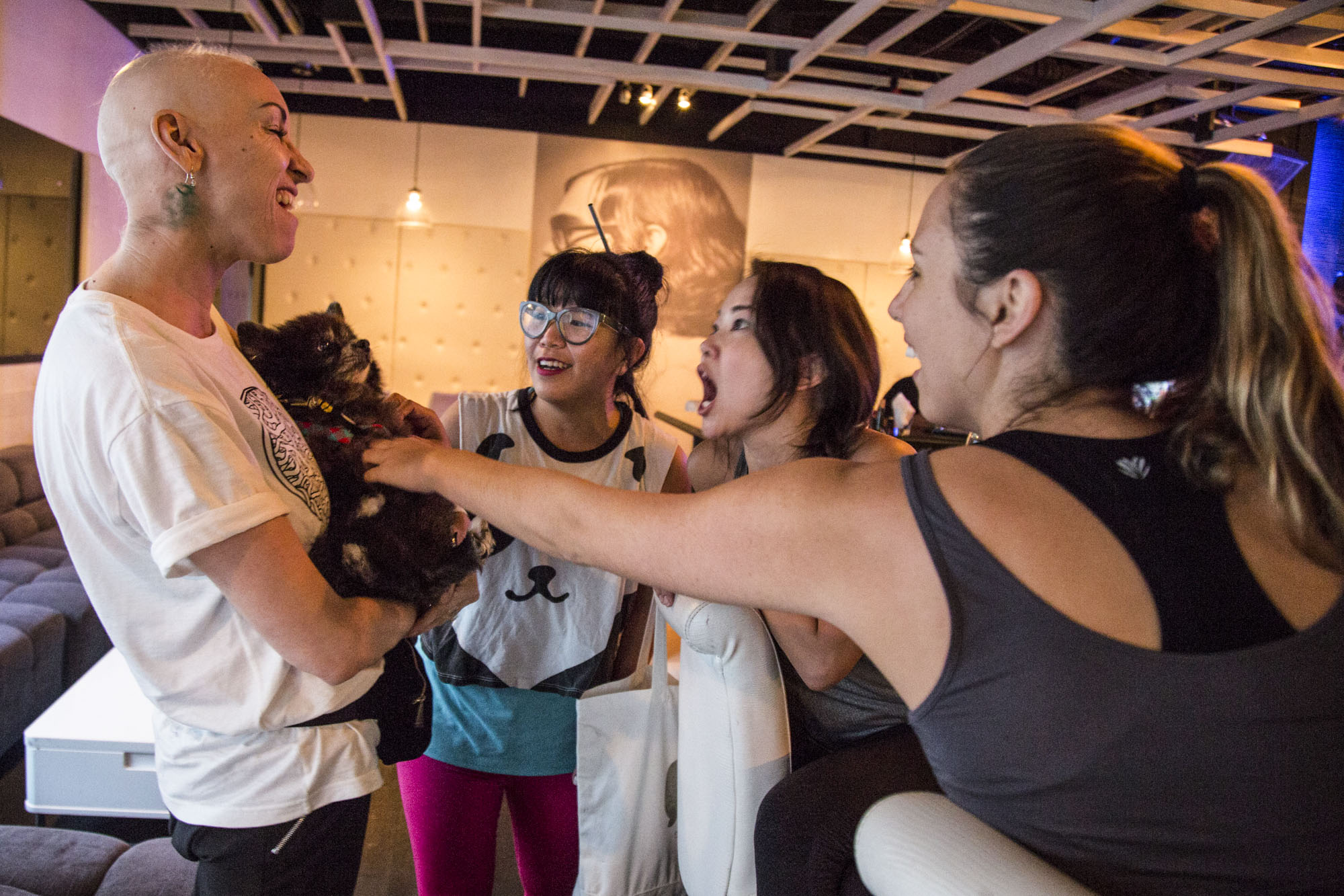 Wittmier excitedly catches up with friends during the Republikʻs first-ever yoga event, ʻYoga Loves CWʻ, an event that was put together in support of Christa.