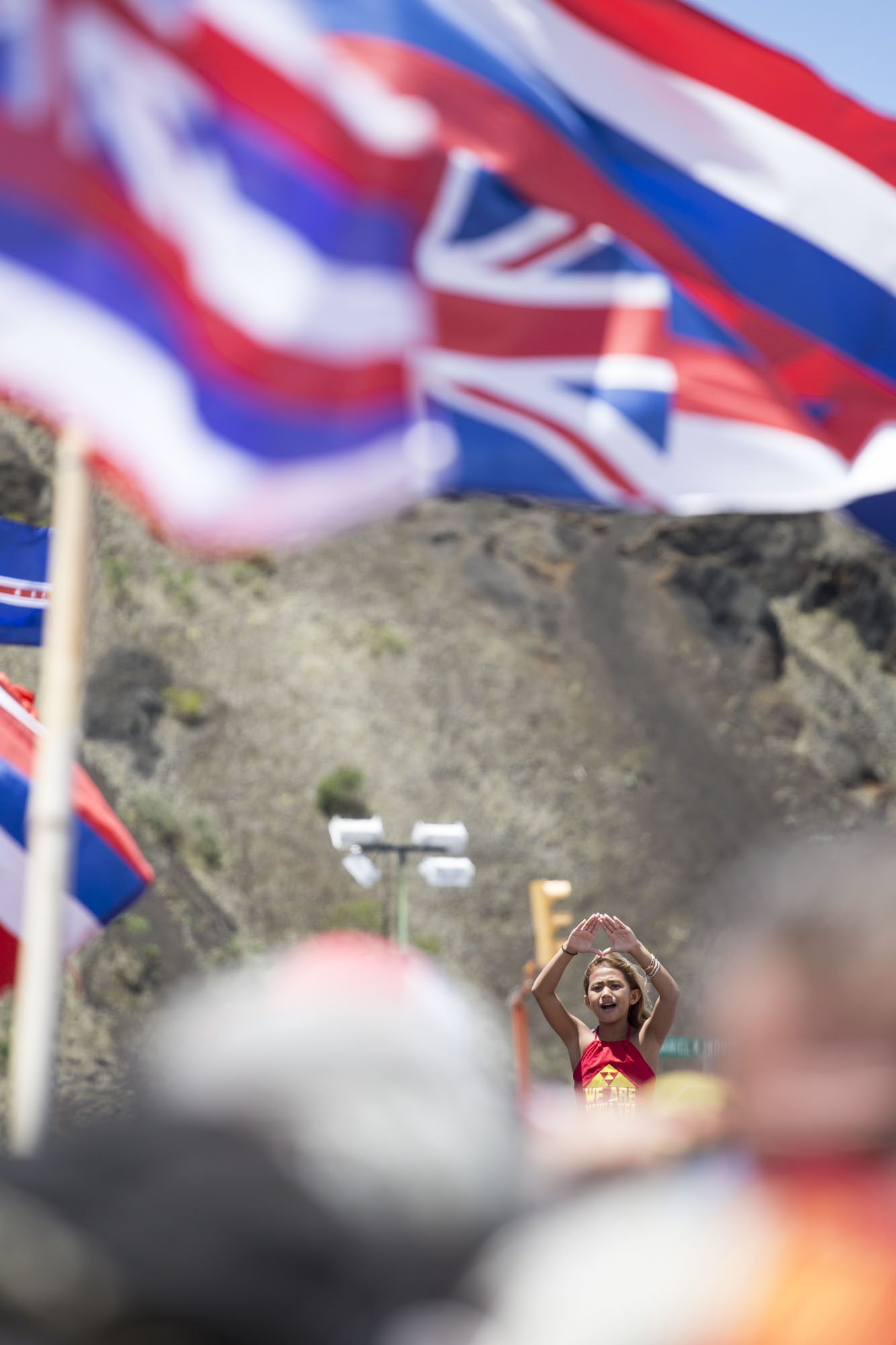 A young girl does the Kū Kiaʻi Mauna (stand guard over the mountain) hand symbol during Jam 4 Maunakea, a worldwide event that took place on August 11, 2019. People from around the world joined the protectors of Maunakea via livestream to sing Kū Haʻaheo and the Hawaiʻi Loa medley.