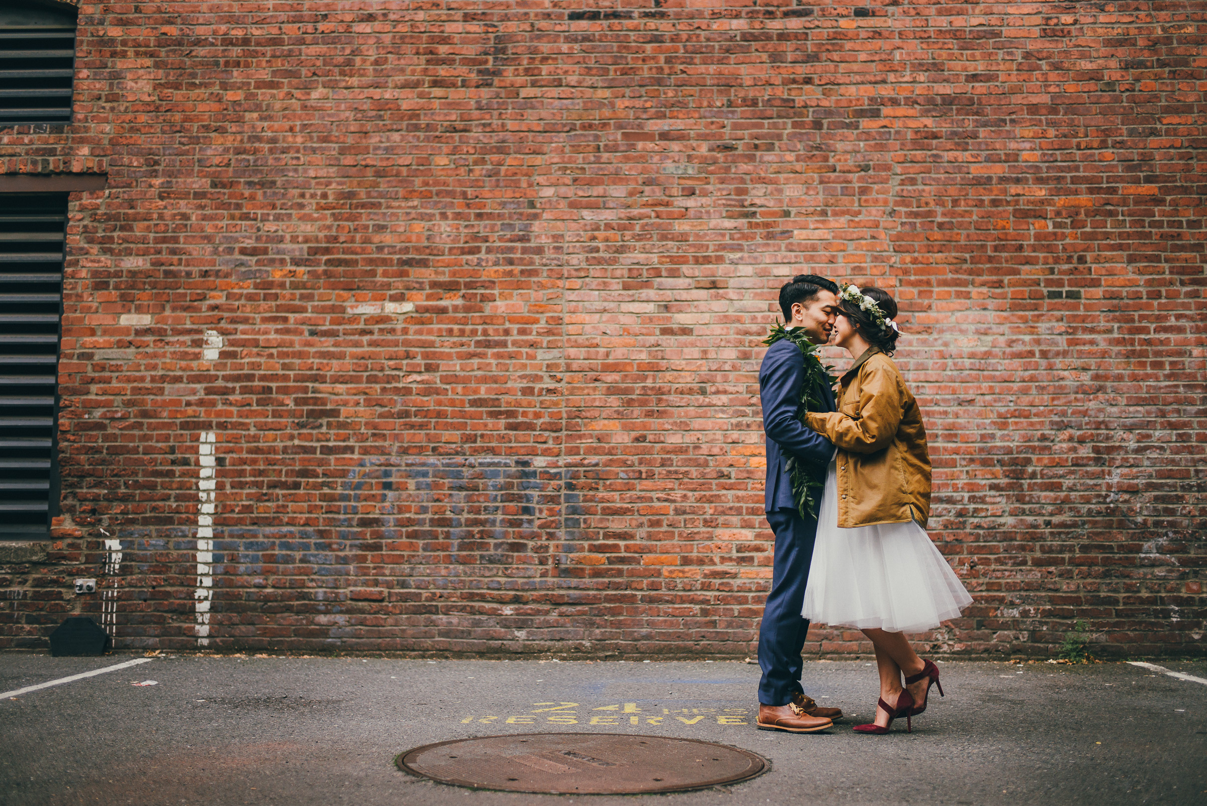 Bride and Groom Portraits with Brick Building in Pioneer Square, Seattle. in Seattle