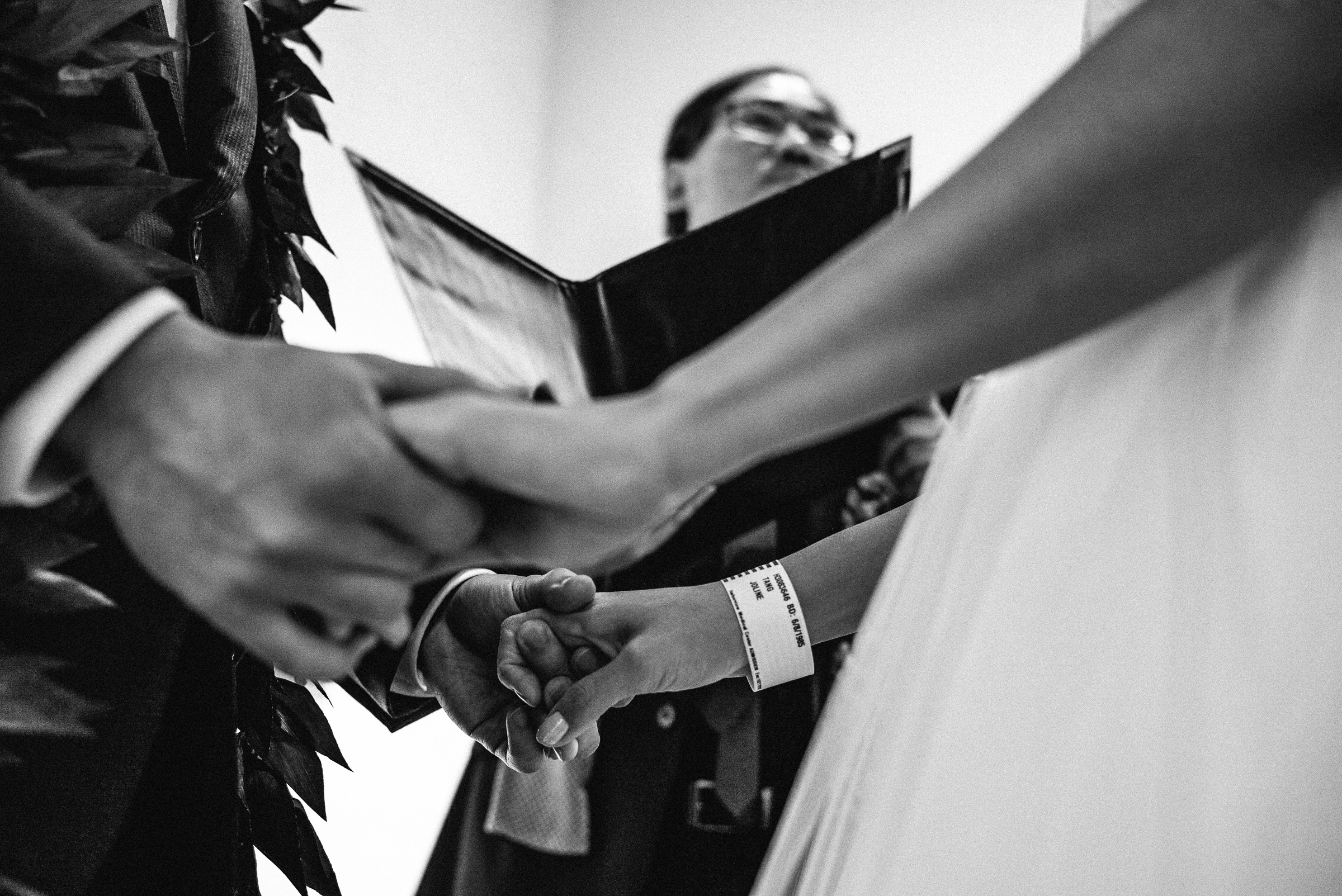 Bride and Groom Holding Hands during Wedding Ceremony in Pioneer Square
