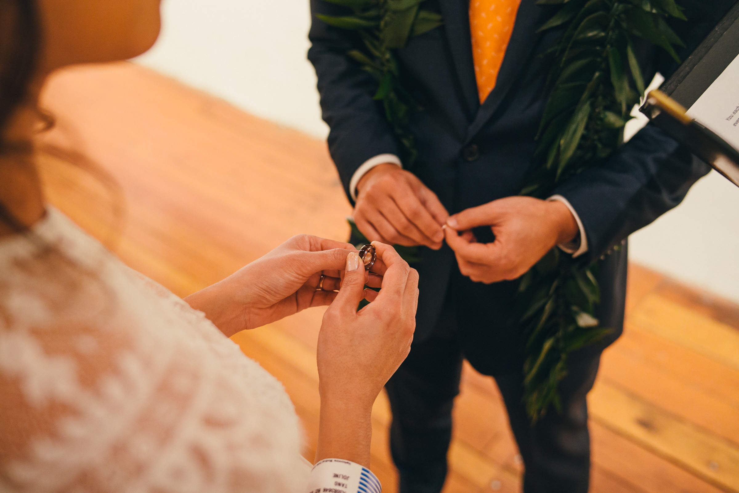 Bridge and Groom Exchanging Rings During Wedding Ceremony in Pioneer Square in Seattle, WA