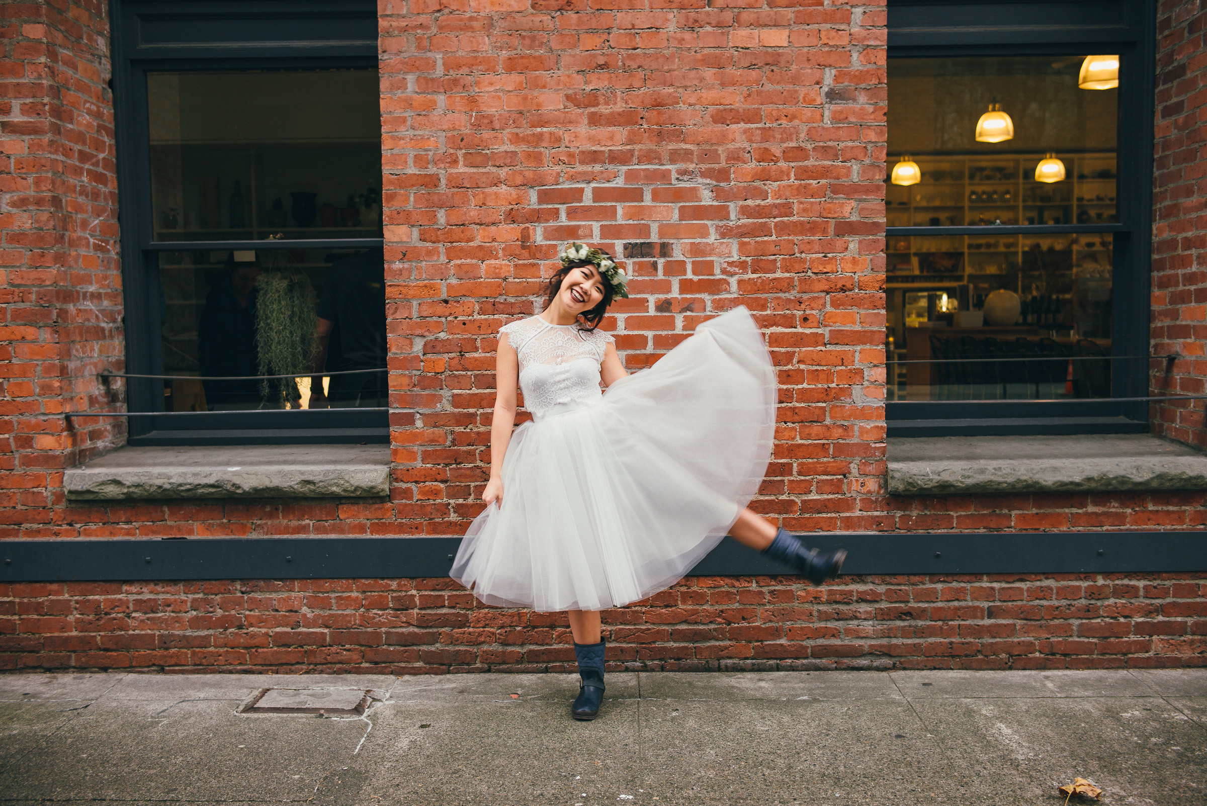 Bride Being Playful on Her Wedding Day in Pioneer Square, Seattle, WA