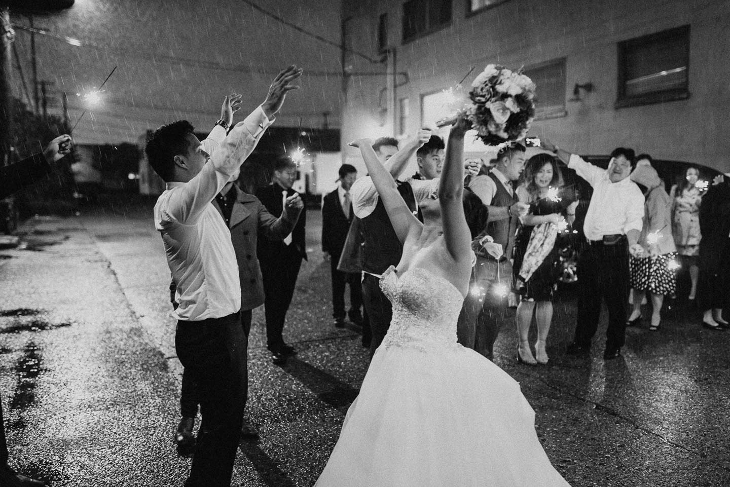 I love how this couple really embraced and enjoyed the rain on their wedding day. This moment made for a few really nice photos of their send-off as the reception came to an end.