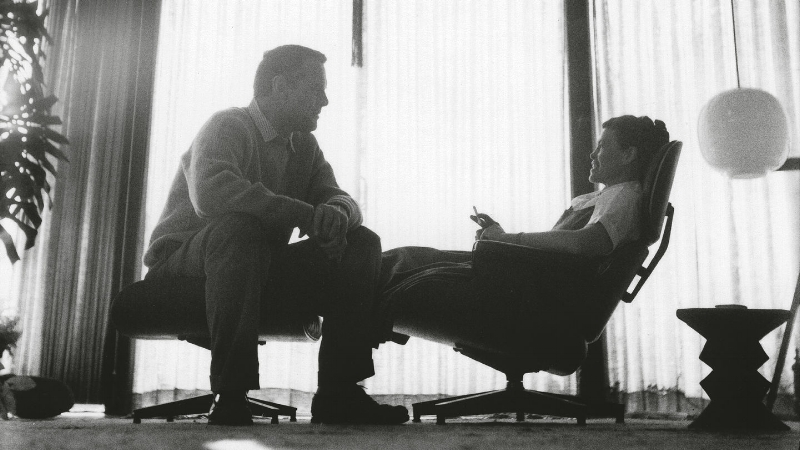 Charles and Ray Eames with the 1956 Lounge Chair