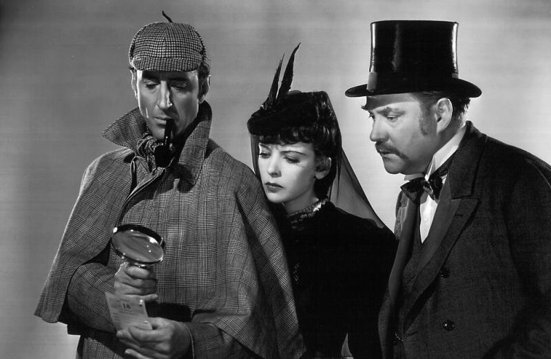 Basil Rathbone (left) as Sherlock Holmes, with Ida Lupino and Nigel Bruce c/o  The Arts Desk