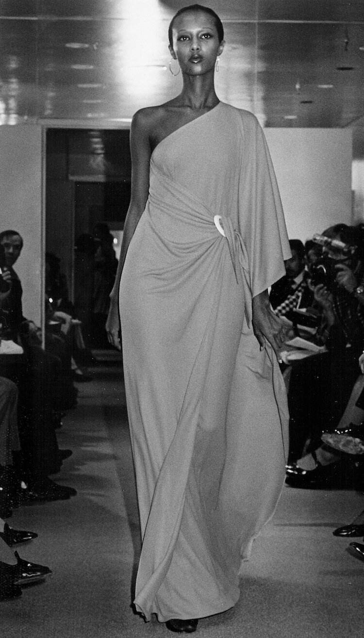 Iman walks the runway in a Halston jersey dress in spring 1976, Pulse Magazine