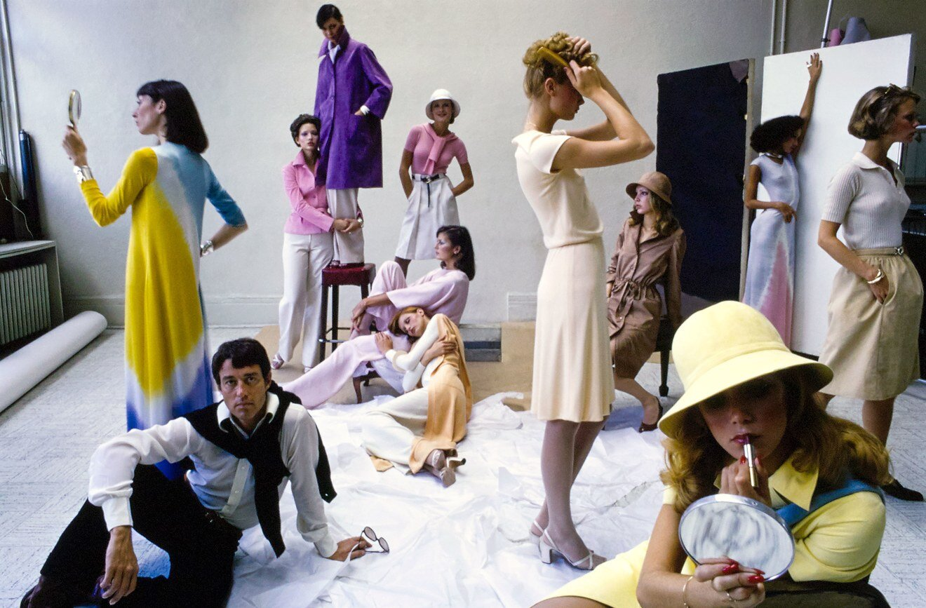 Halston, bottom left, and models in his designs. Photographed by Duane Michals, Vogue , December 1, 1972