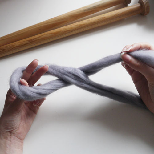 Step 1 - Start by making a slip knot - twist the wool around itself with the longest tail underneath & use your left hand to go inside the loop and grab the yarn (attached to the ball not the smallest tail)...