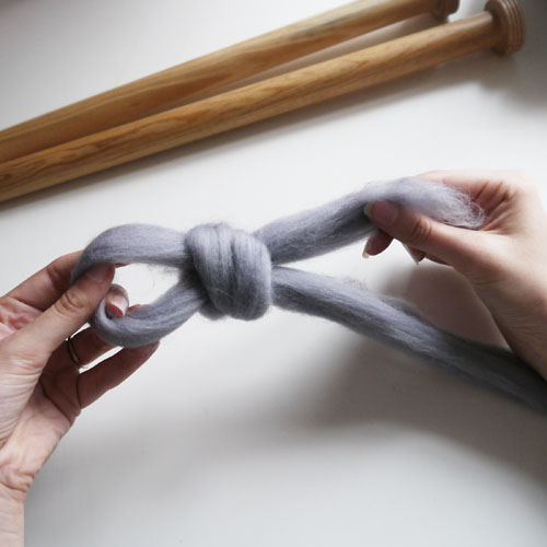 Step 2 - Pull the yarn through the loop and tighten it to create your slip knot.