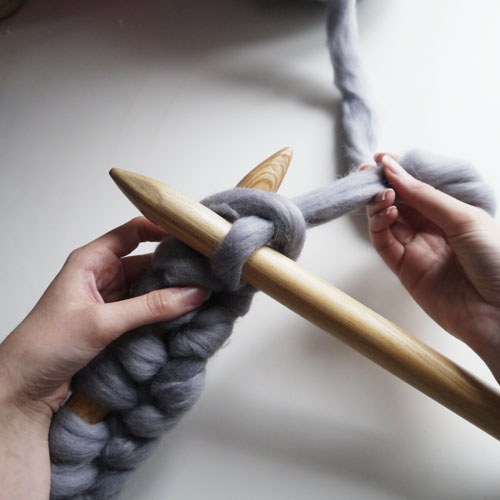 Step 2 - Pull the yarn under so that the right hand needle is on top of the left hand needle...